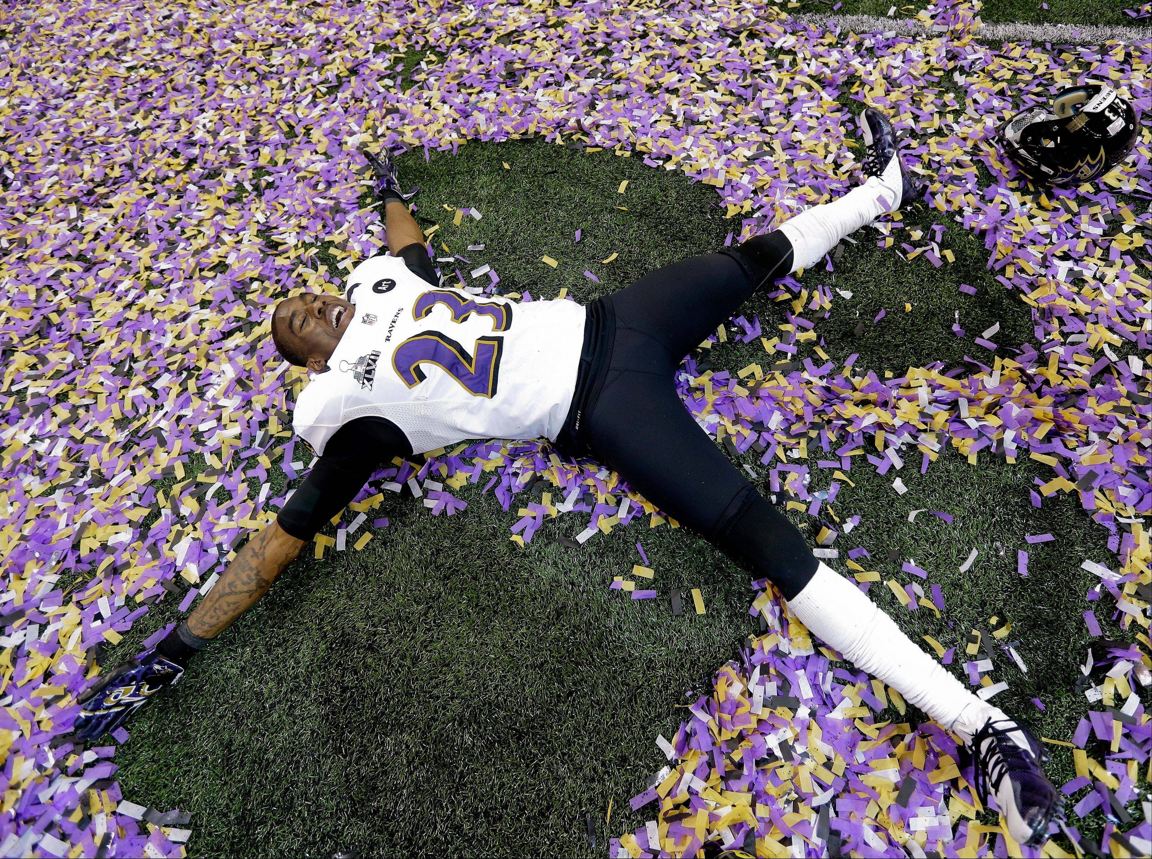 Baltimore Ravens defensive back Chykie Brown (23) lies in the confetti after defeating the San Francisco 49ers 34-31 in Super Bowl XLVII last night in New Orleans.