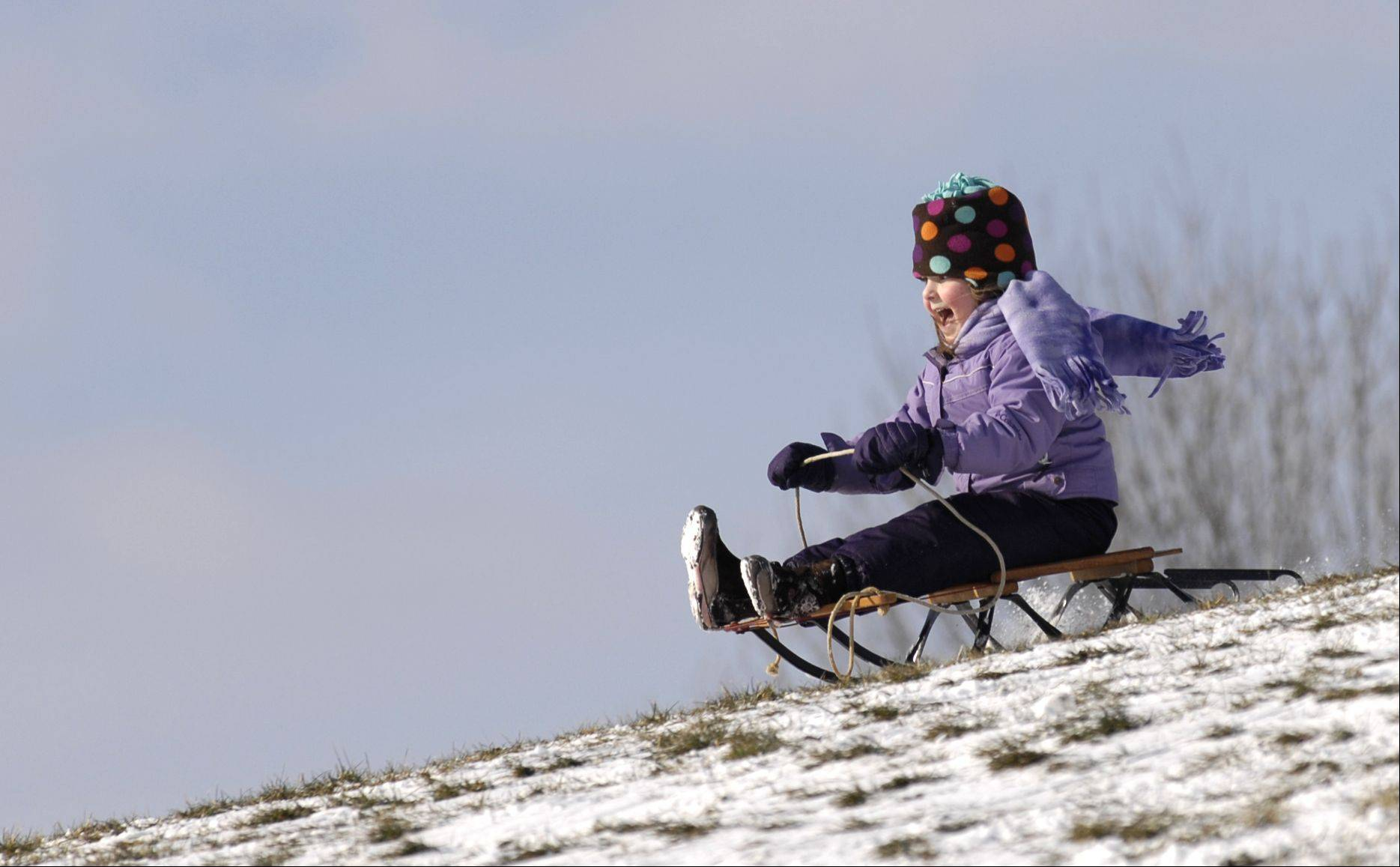 Ellen Benes, 5, of Glen Ellyn, takes a ride at Newton Park in Glen Ellyn Sunday.
