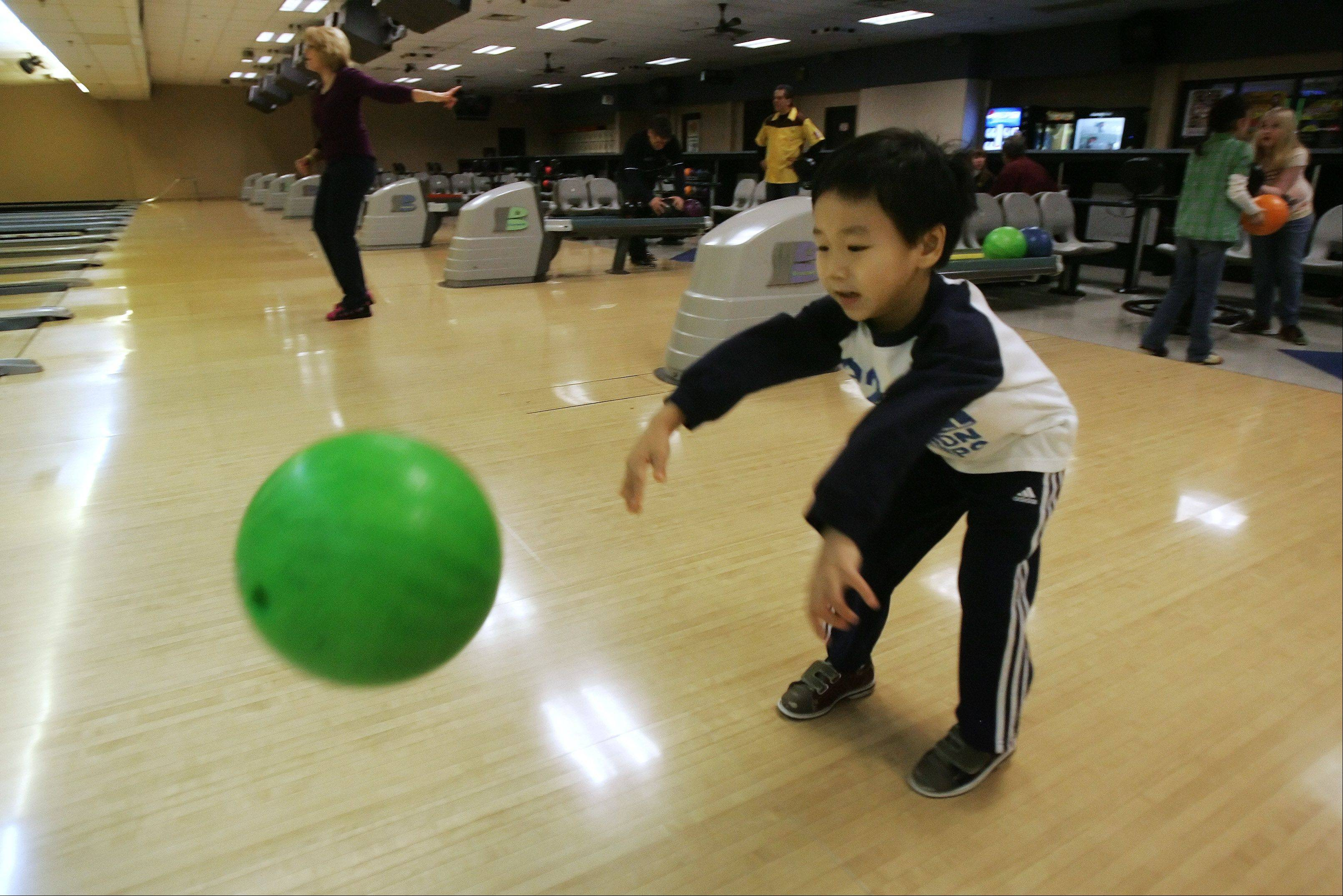 Five-year-old Harrison Zhang, of Brookfield, bowls during the Fourth Annual Football Sunday Benefit for the Little Angels Center for Exceptional Care at Arlington Lanes Bowl Sunday in Arlington Heights. The fundraiser was hosted by the Schaumburg-Hoffman Lions Club and featured unlimited bowling, a buffet and a silent auction.