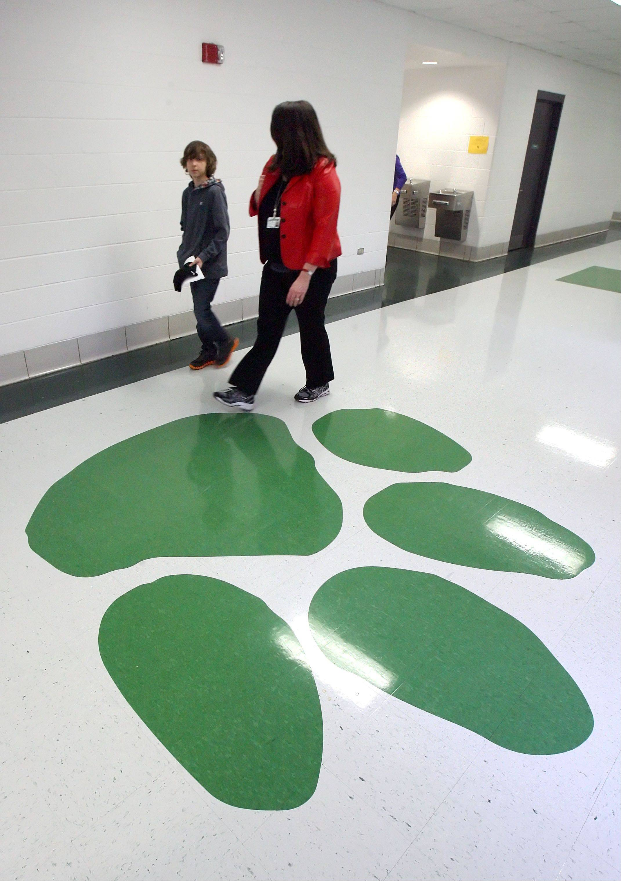 "Woodland Middle School seventh grade student Jack Hodapp and Dist. 50 Superintendent Joy Swoboda roam the halls of Woodland Middle School in Gurnee. Hodapp shadowed Swoboda as he was ""Superintendent for a Day."""