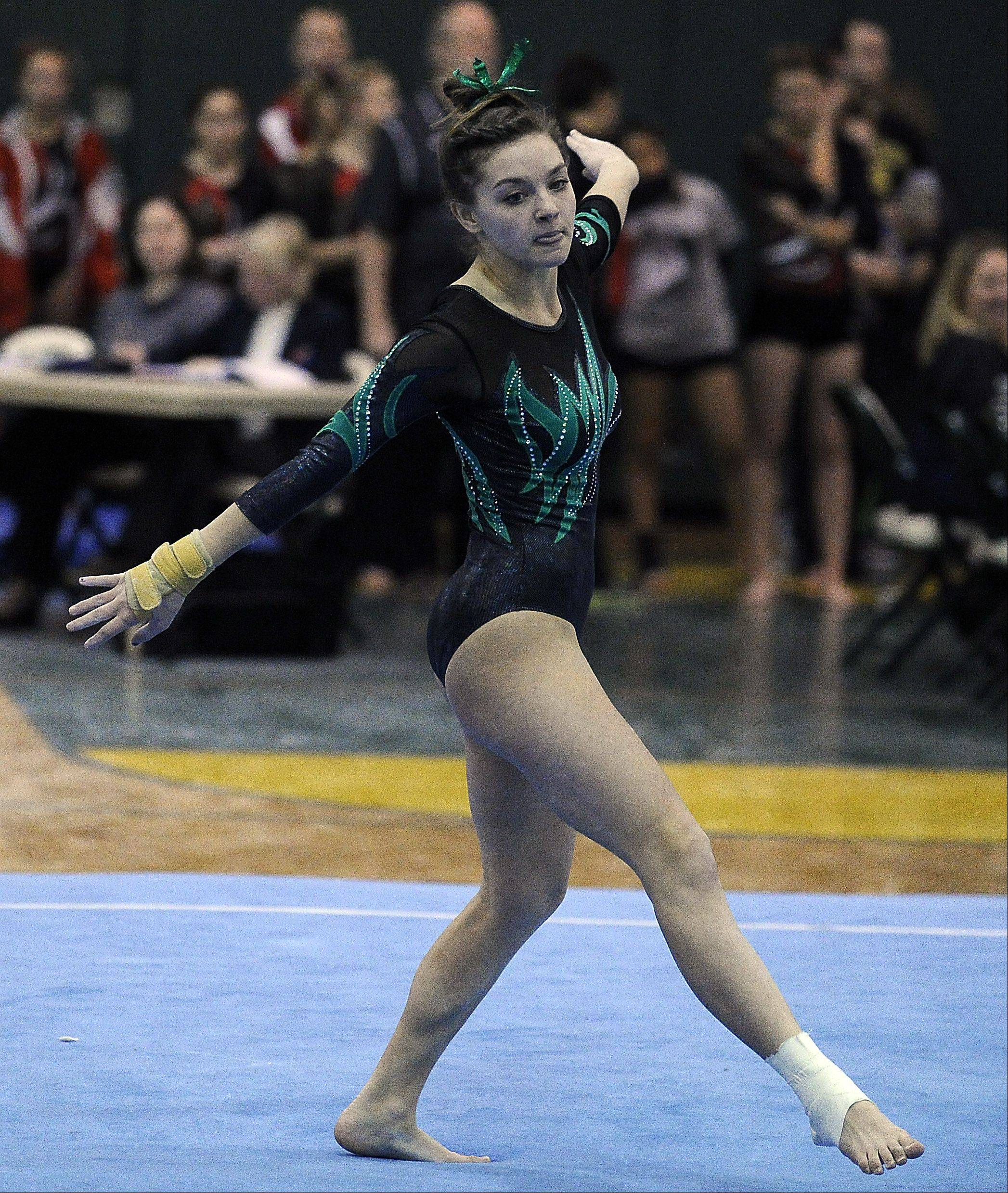 Fremd's Christine Radochonski works floor exercise during sectional action Monday at Fremd.