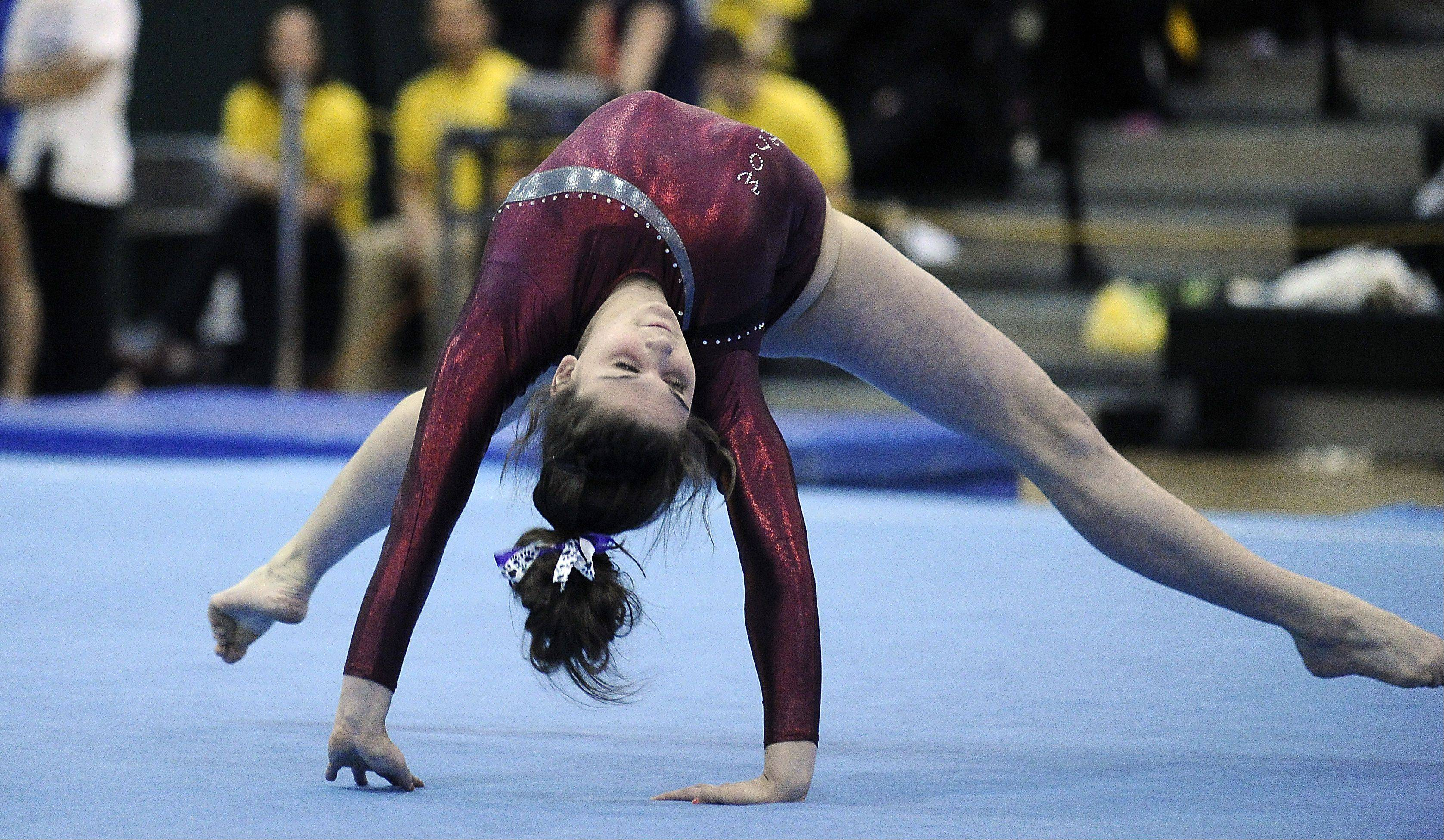 Prairie Ridge's Rachael Underwood works floor exercise during sectional action Monday at Fremd.