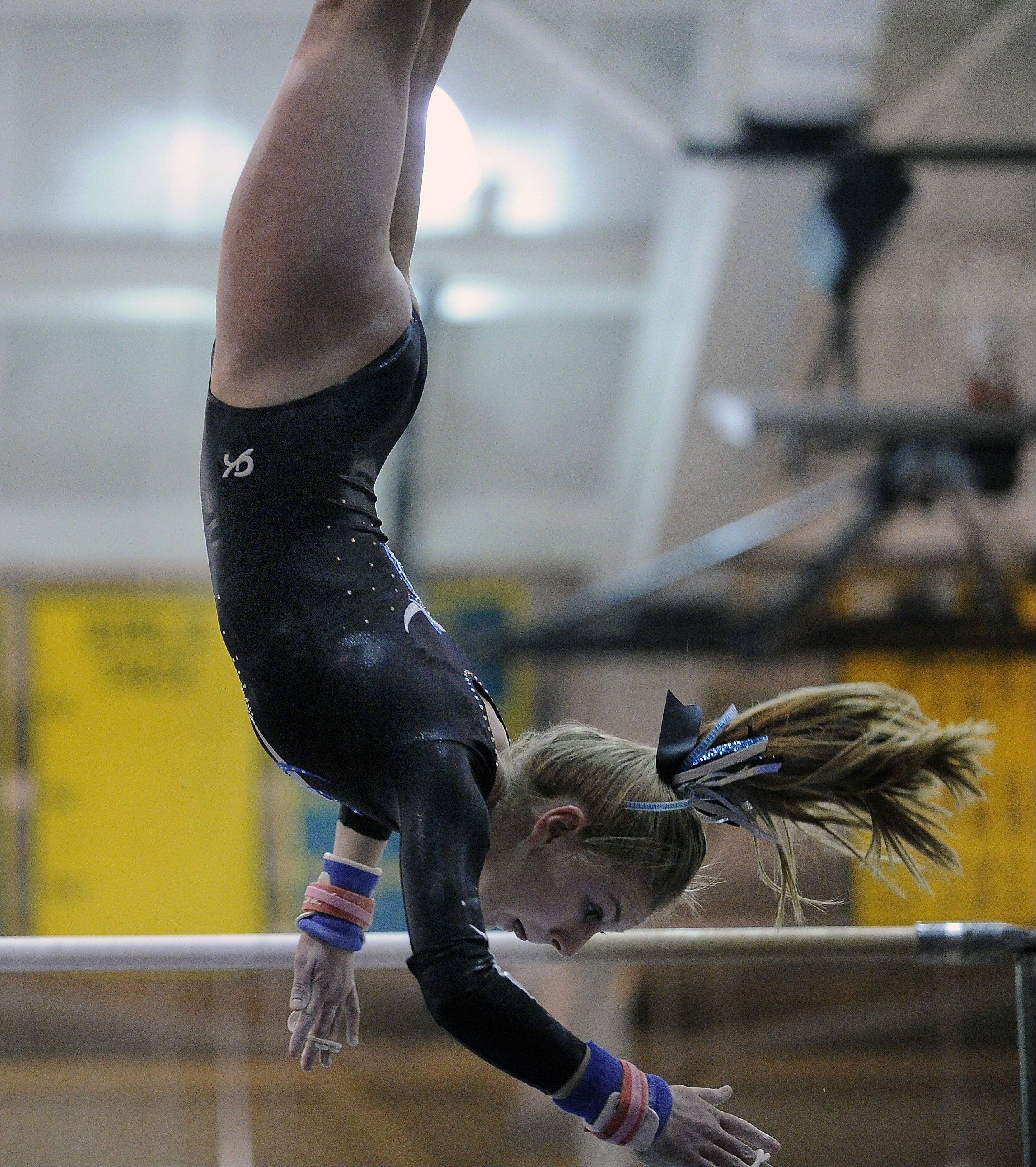 Mark Welsh/mwelsh@dailyherald.comProspect's Maddie Boldt works the uneven parallel bars during sectional action Monday at Fremd.