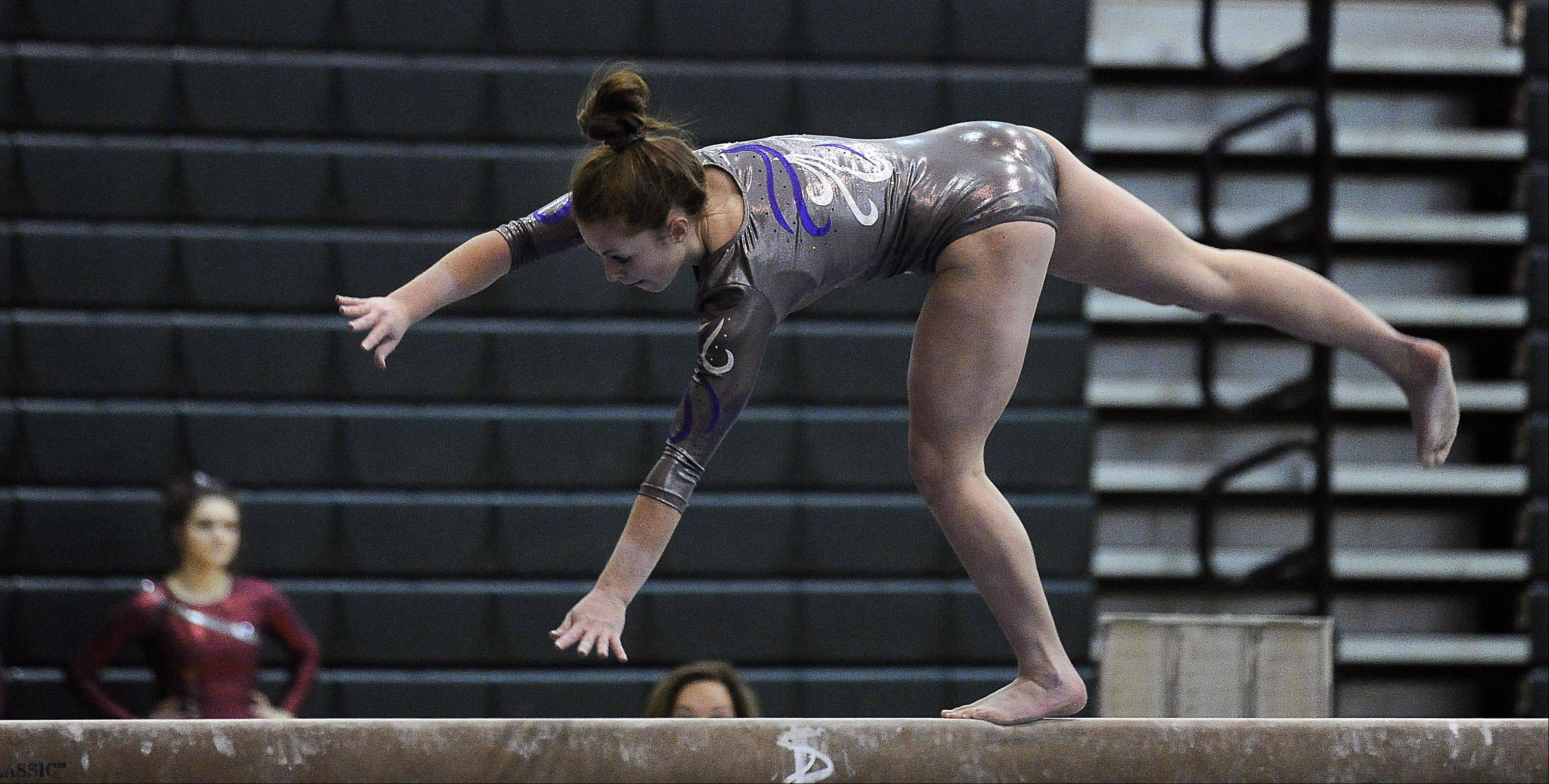St. Edward's Abby Madden on the balance beam during sectional action Monday at Fremd.