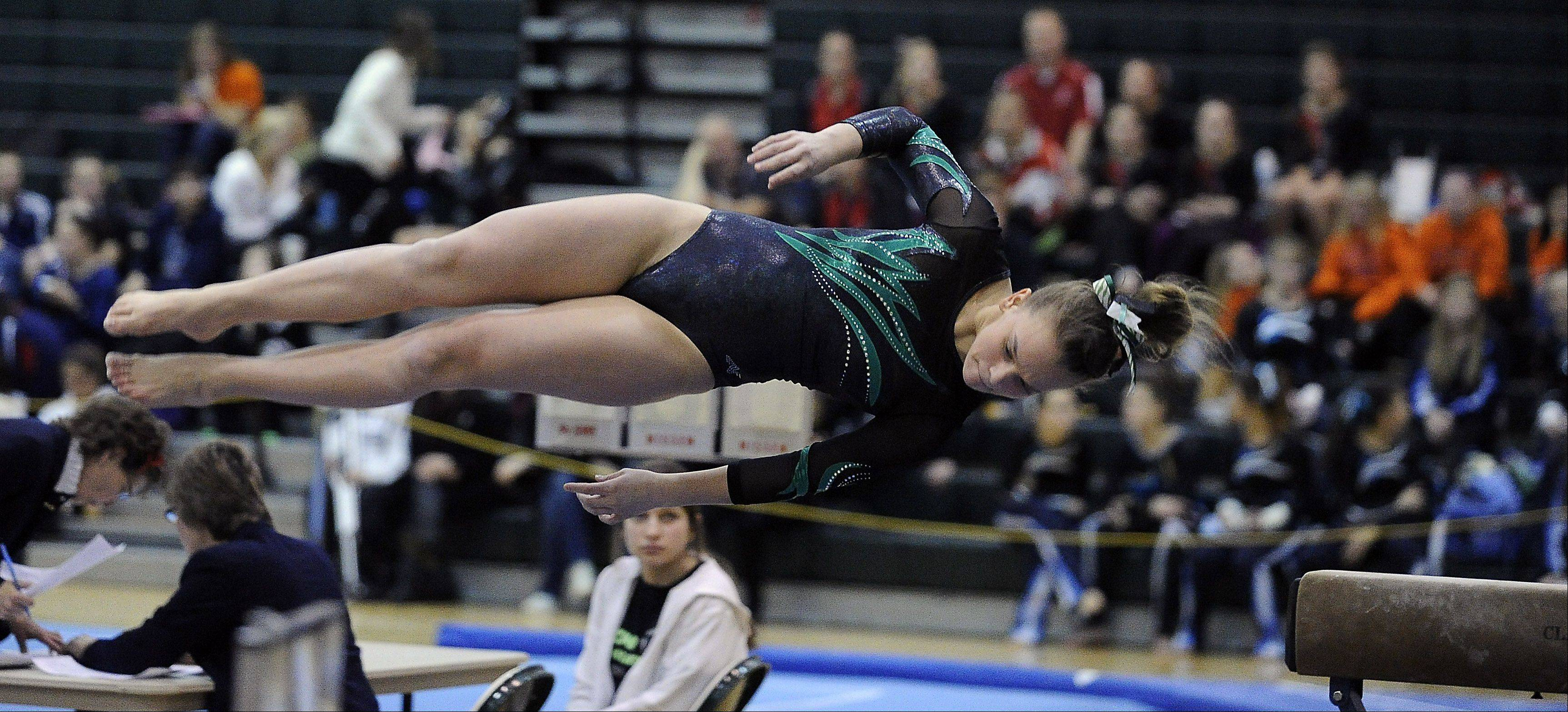 Mark Welsh/mwelsh@dailyherald.comFremd's Lisa Radochonski on the balance beam during sectional action Monday at Fremd.