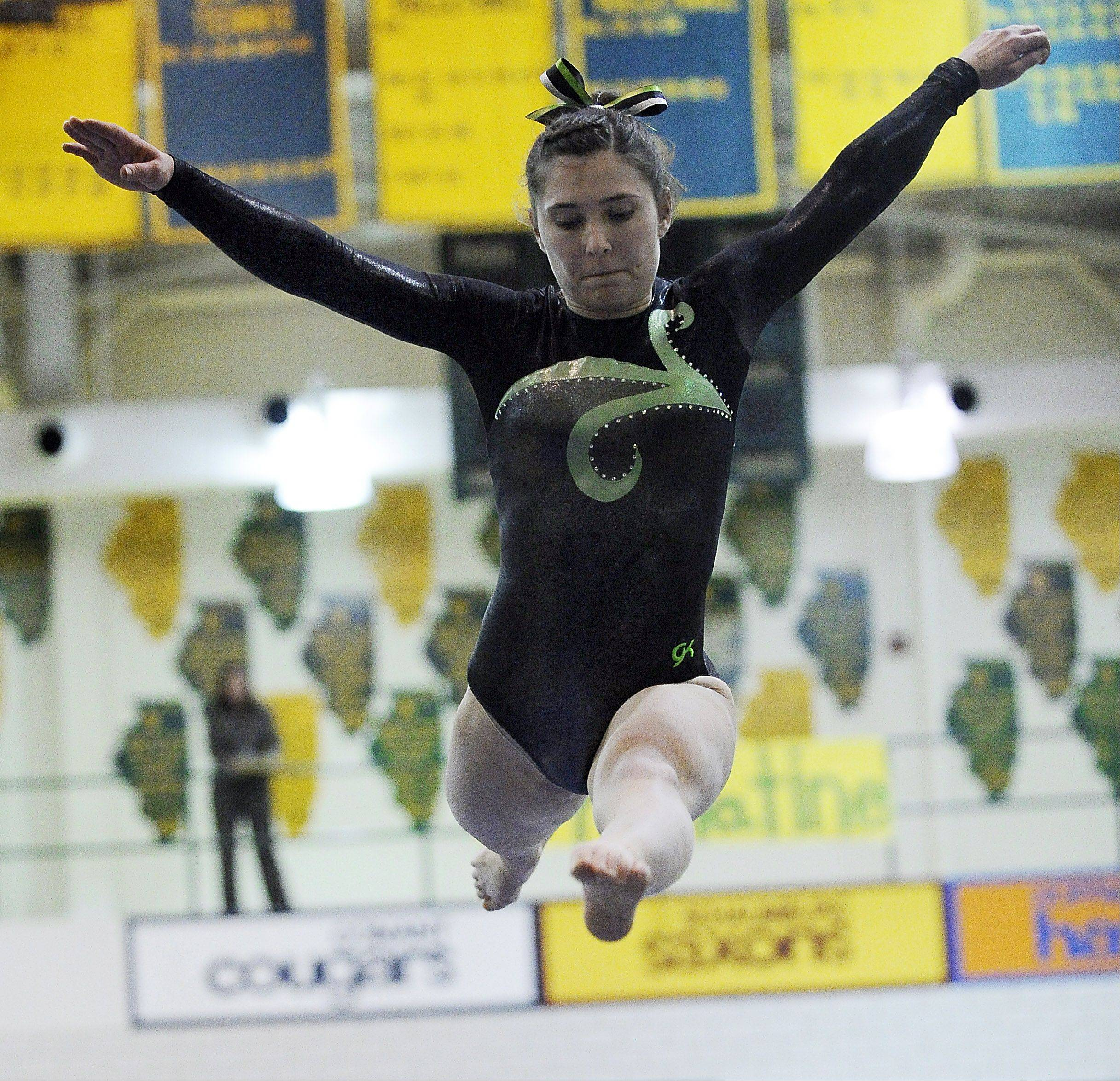 Elk Grove's Amelia Rafferty eyes the beam for her landing during sectional action Monday at Fremd.