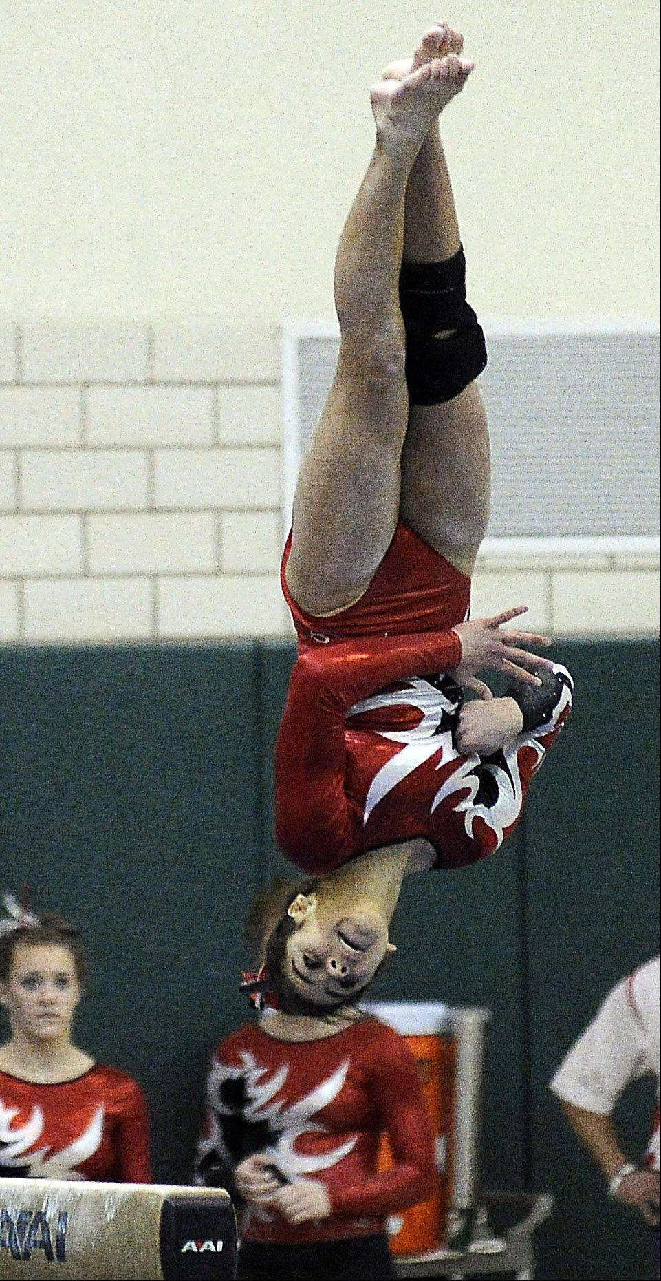 Barrington's Abby Hasanov on the balance beam during sectional action Monday at Fremd.
