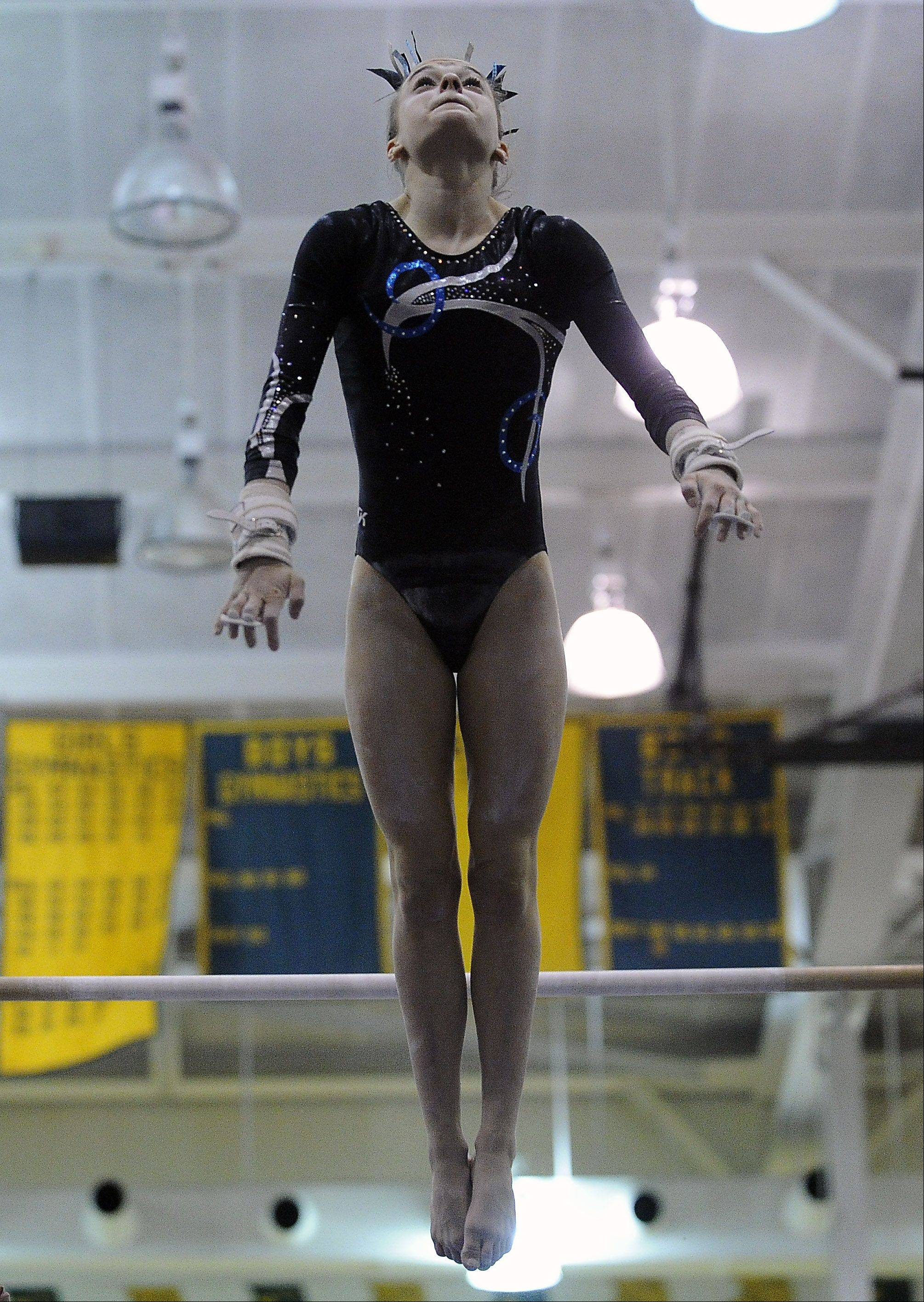 Prospect's Maddie Larock on the uneven parallel bars during sectional action Monday at Fremd.