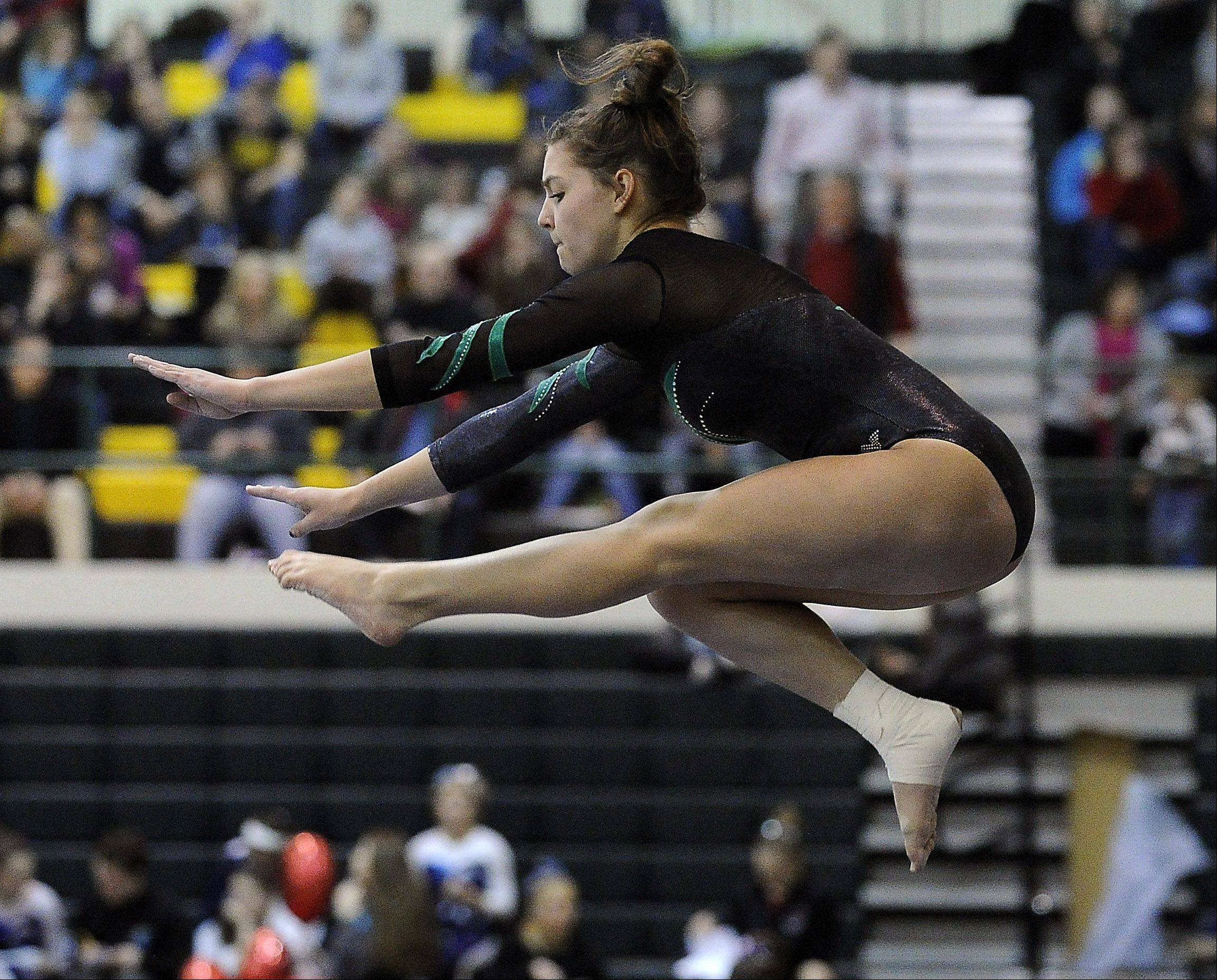 Fremd's Christine Radochonski on the balance beam during sectional action Monday at Fremd.