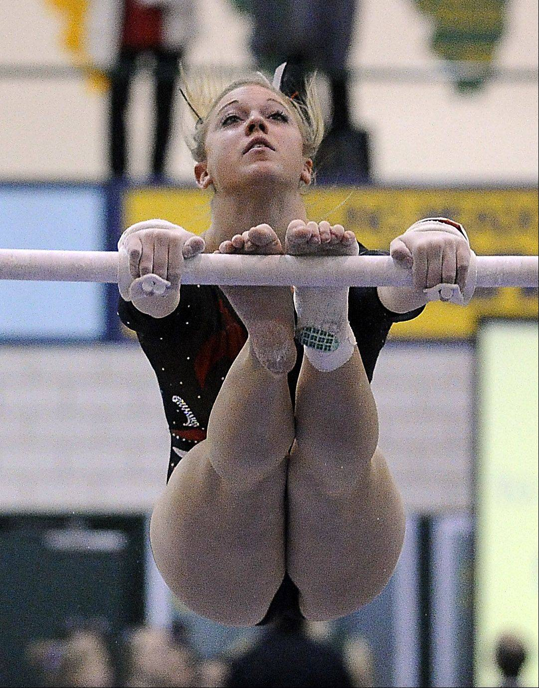 Palatine's Abby Alden rolls off the uneven parallel bars during sectional action Monday at Fremd.