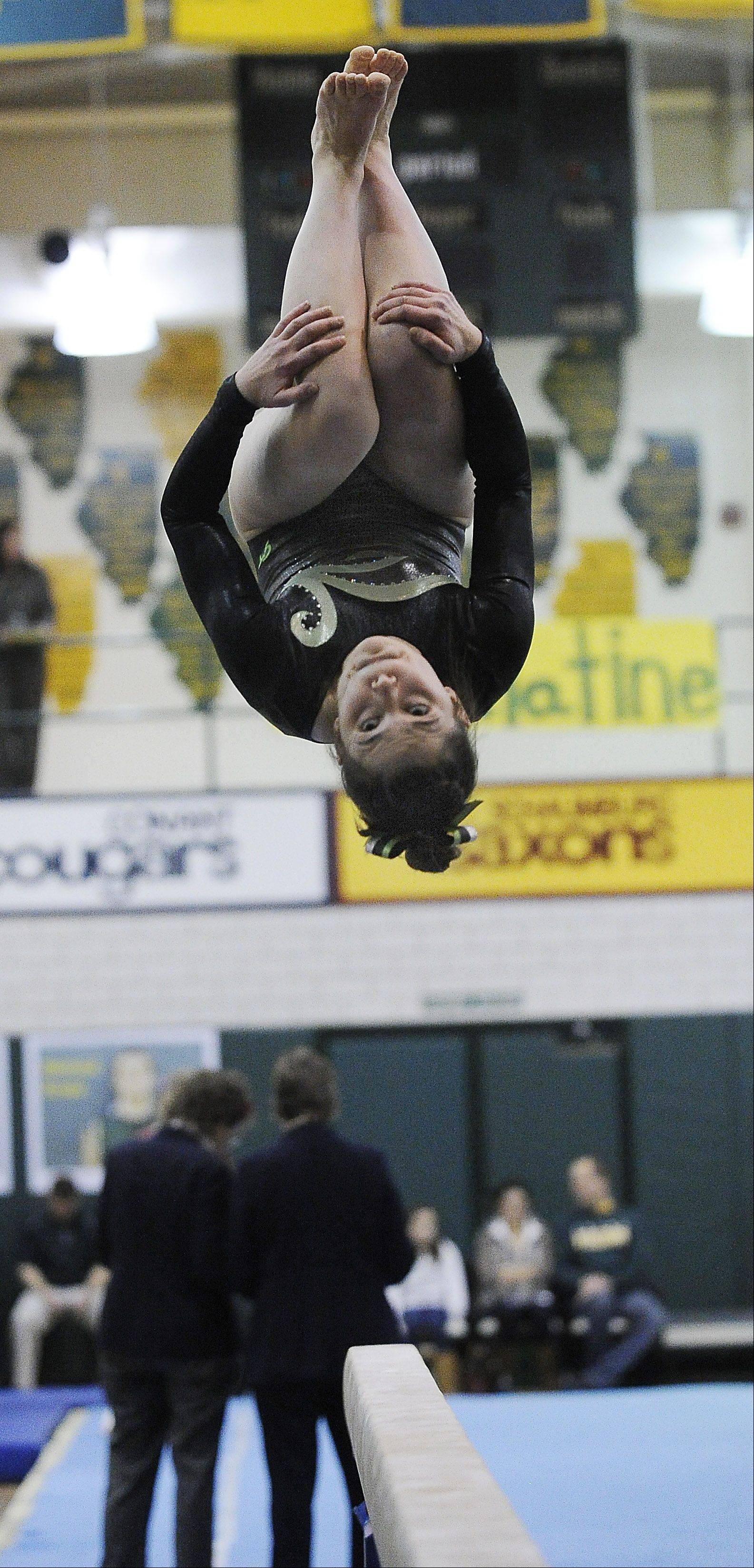 Elk Grove's Amelia Rafferty eyes the beam for her landing after her flip during sectional action Monday at Fremd.