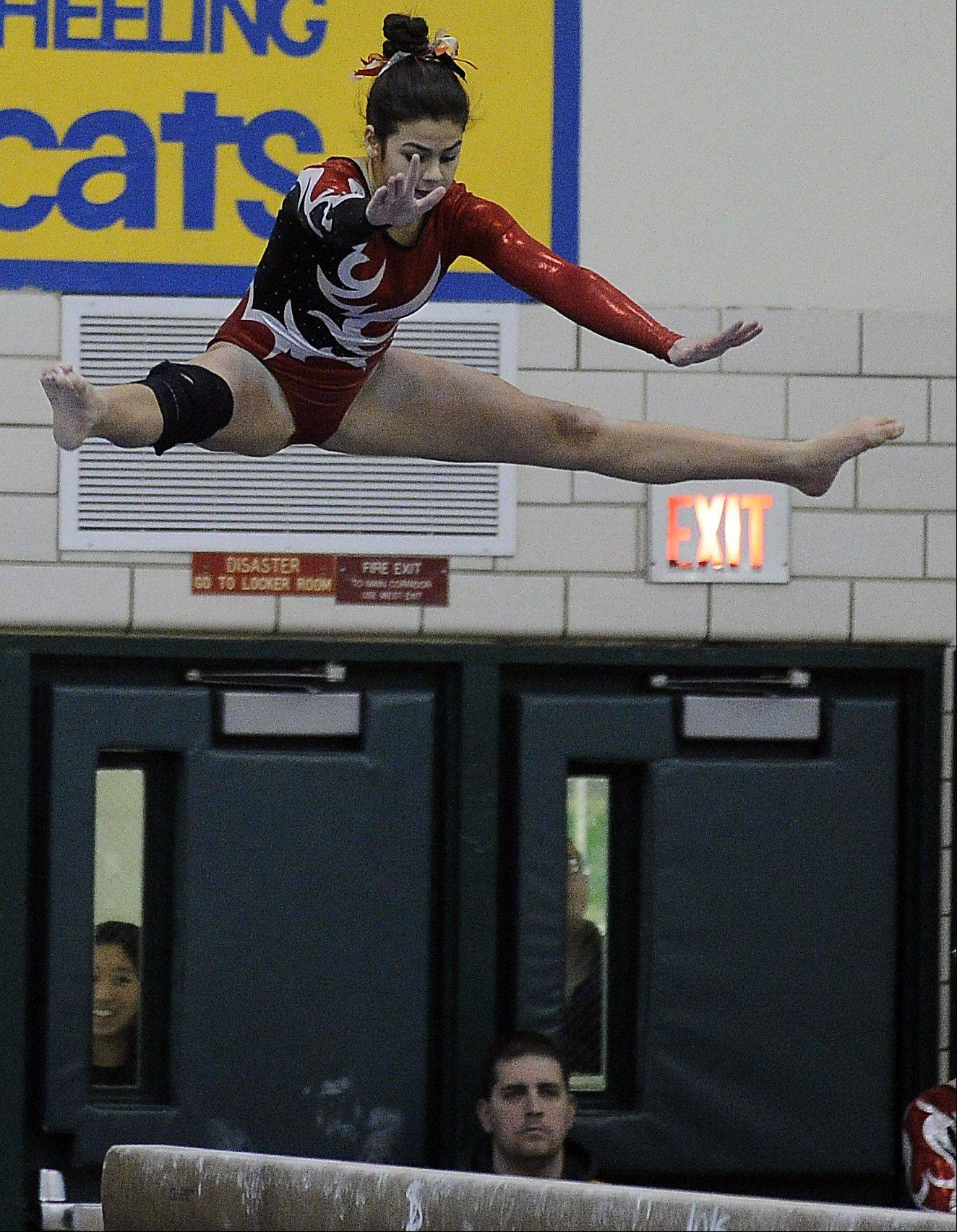 Barrington's Abby Hasanov on balance beam during sectional action Monday at Fremd.