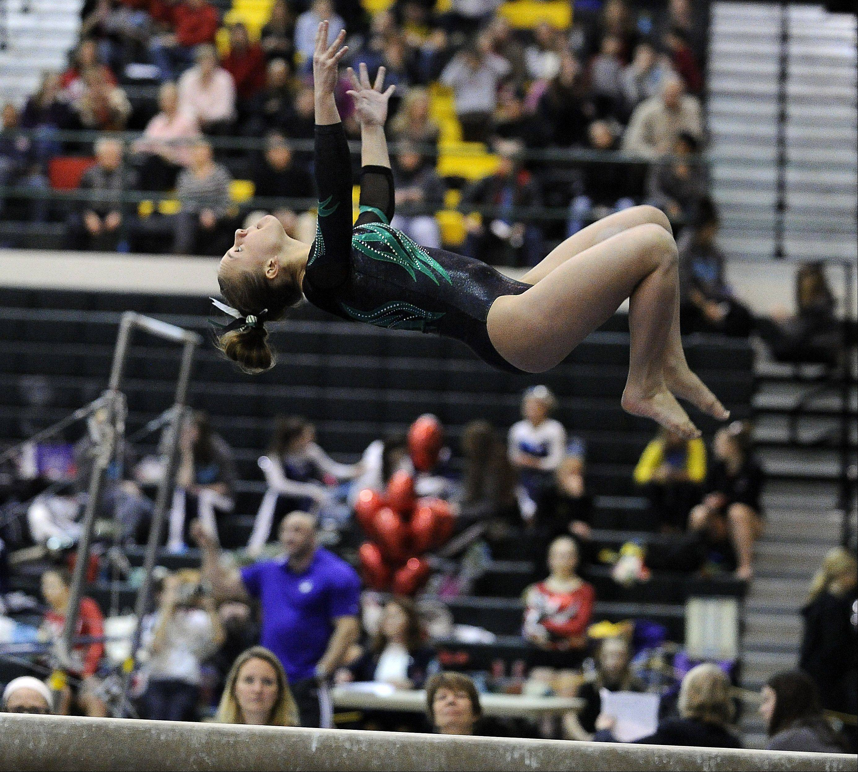 Fremd's Lisa Radochonski on the balance beam during sectional action Monday at Fremd.