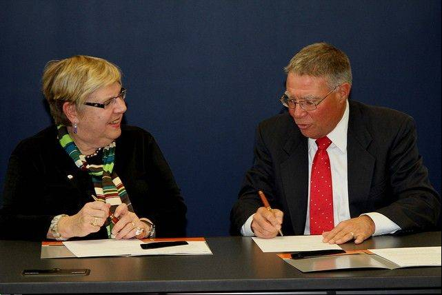 Harper College President Dr. Kenneth Ender, right, and Governors State University President Dr. Elaine Maimon prepare to sign a new Dual Degree Program agreement.