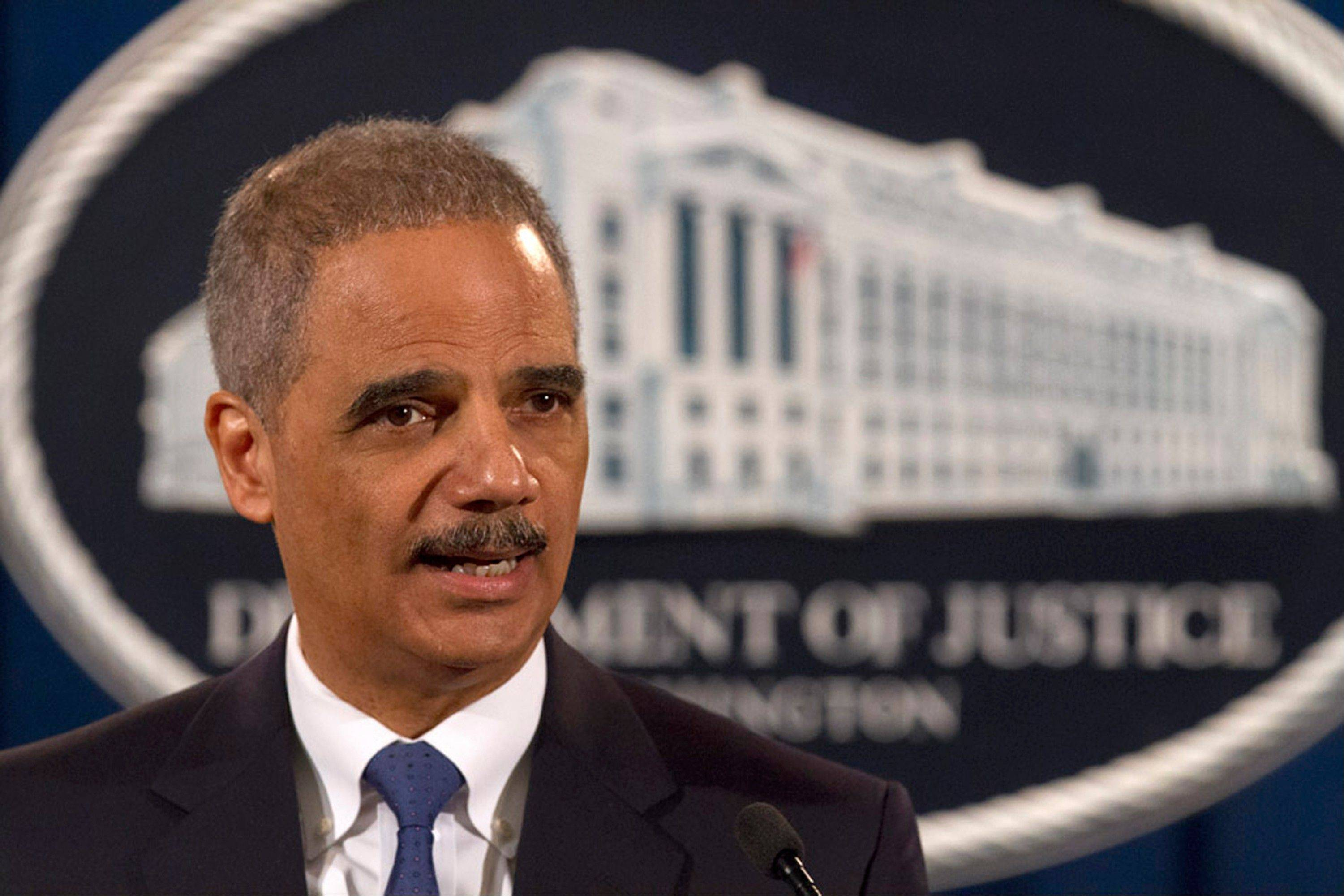 Attorney General Eric Holder speaks at the Justice Department in Washington Tuesday. The U.S. government accused Standard & Poor�s of inflating ratings on mortgage investments to boost its bottom line, taking aim at a key player in the run-up to the financial crisis.