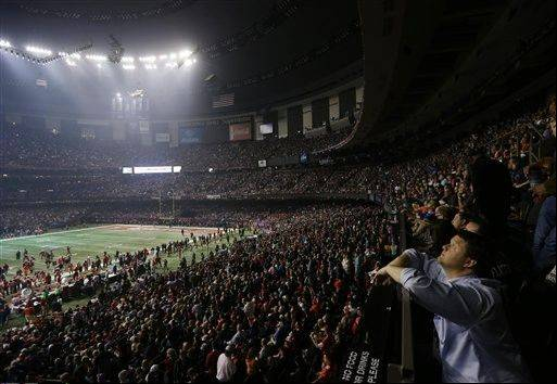 Fans and members of the Baltimore Ravens and the San Francisco 49ers wait for power to return in the Superdome during an outage in the second half of the NFL Super Bowl XLVII football game, Sunday.