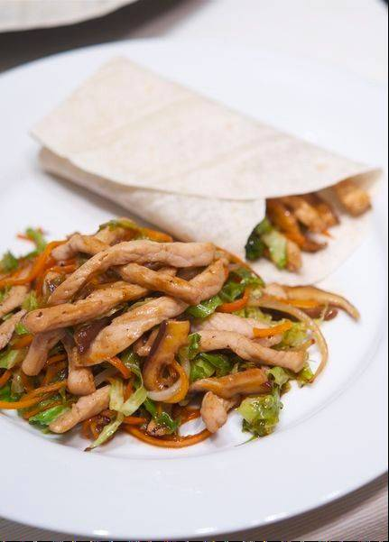 If you can't find moo shu pancakes at the store, use flour tortillas to wrap up homemade moo shu pork.