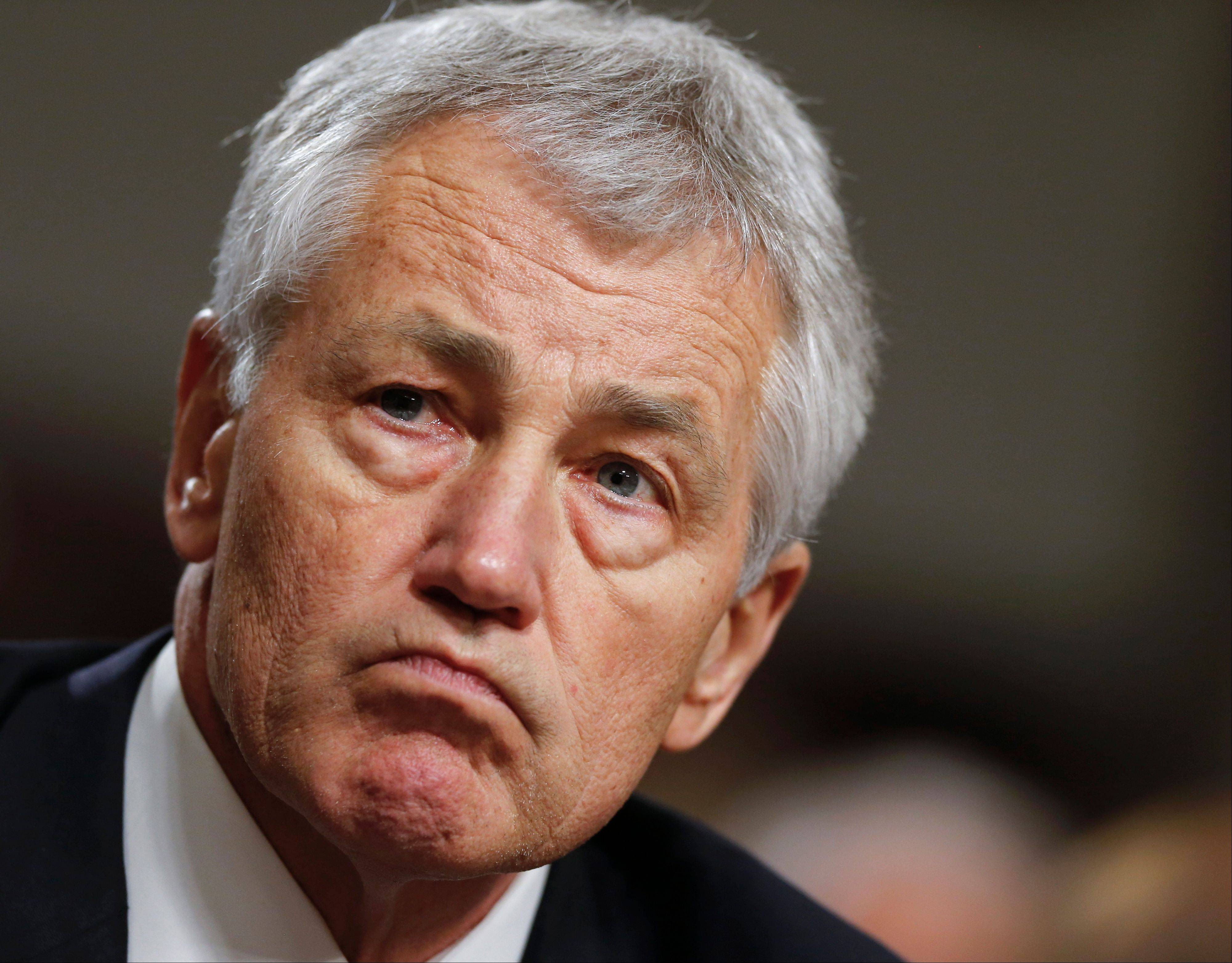 Former Nebraska Sen. Chuck Hagel testifies on Capitol Hill in Washington before the Senate Armed Services Committee�s confirmation hearing. Senate Minority Leader Mitch McConnell of Ky. is raising the possibility of a filibuster of Hagel to be defense secretary.