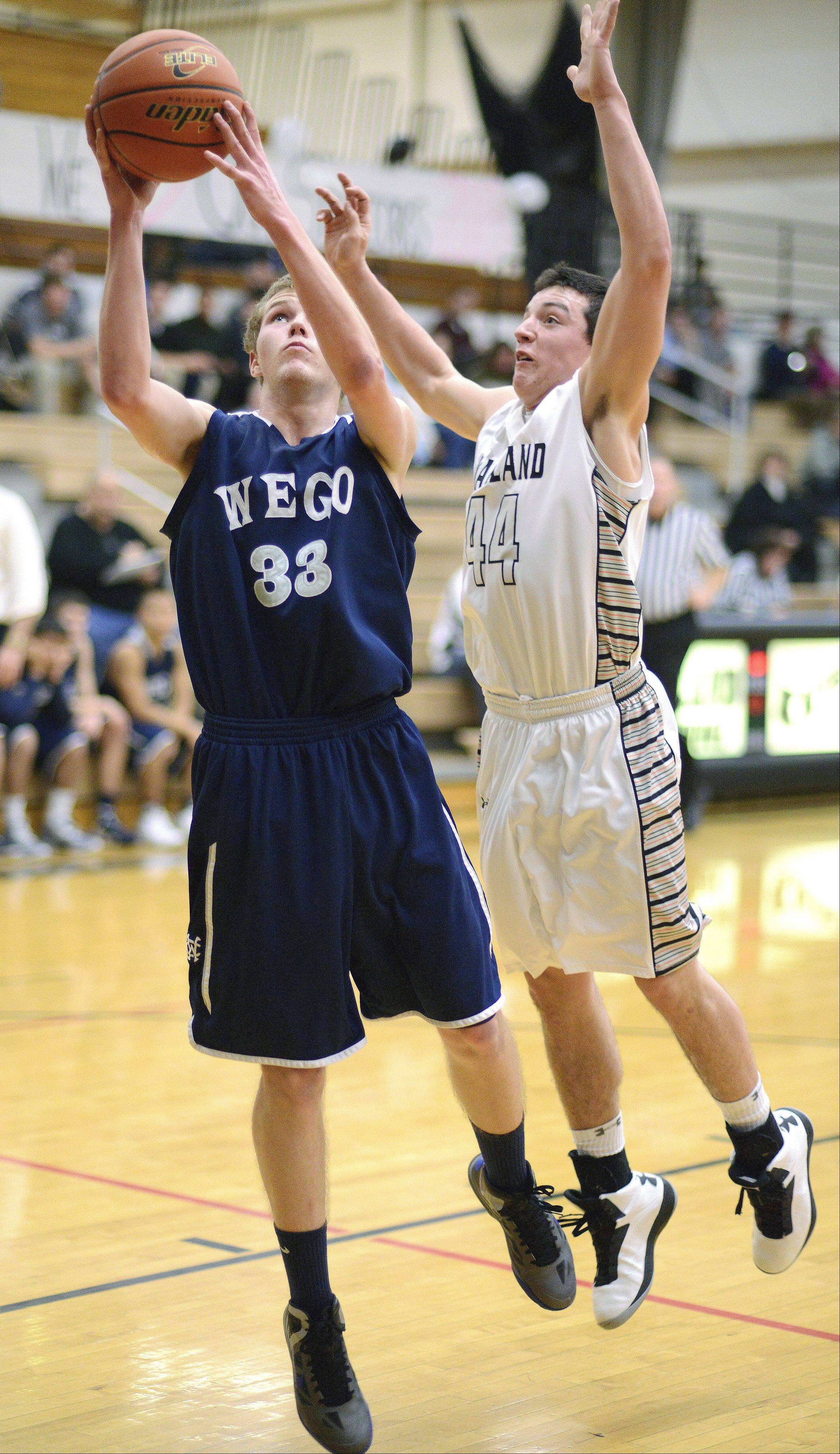 West Chicago�s Mike Zajac is fouled by Kaneland�s Matt Limbrunner as he makes a shot for the basket in the third quarter on Tuesday, February 5.