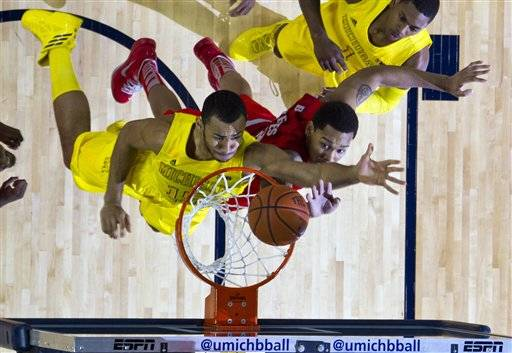 Tim Hardaway Jr. brought Michigan back with a relentless streak of 3-point shooting, then blocked a shot by Aaron Craft in the final seconds of overtime to give the third-ranked Wolverines a 76-74 victory over No. 10 Ohio State on Tuesday night.
