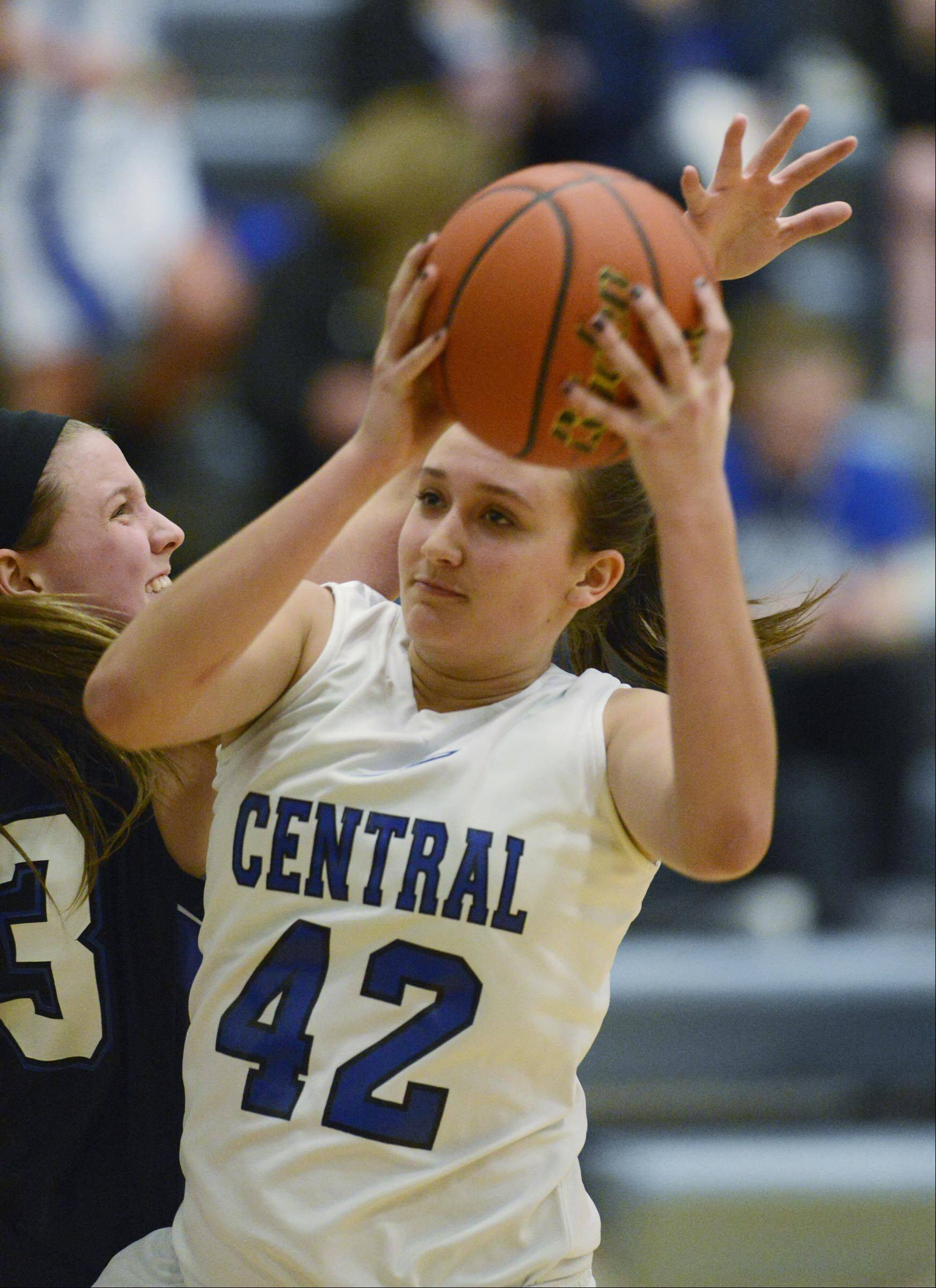 Burlington Central�s Alison Colby (42) gets past St. Charles North�s Nicole Davidson Tuesday in Burlington.