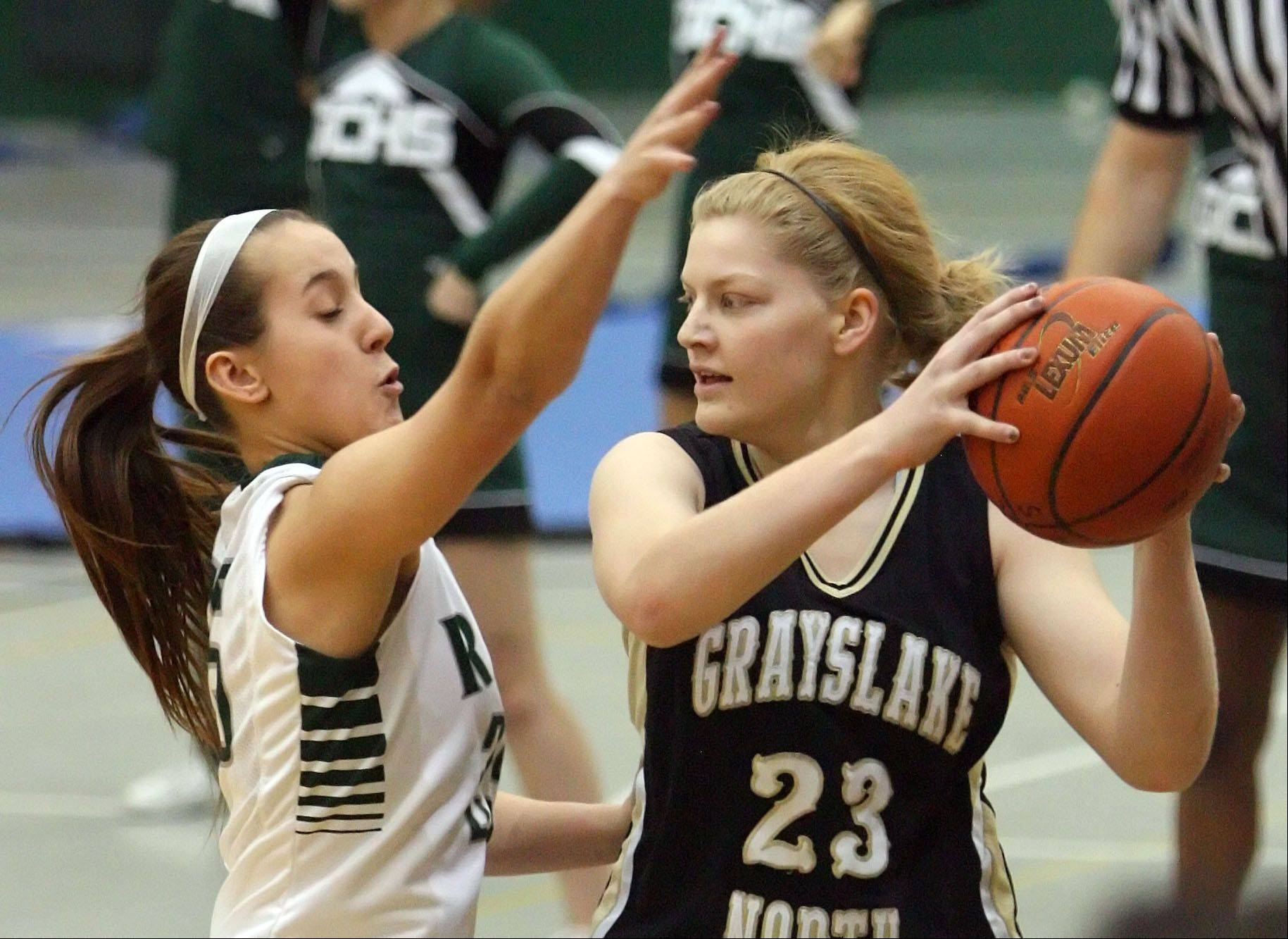 Grayslake Central�s Taylor Peterson, left, ddefends against Grayslake North�s Joanna Guhl.