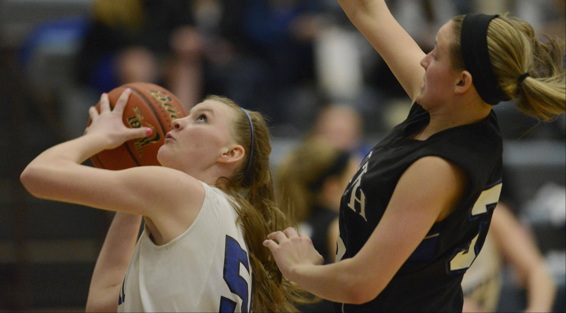 Burlington Central�s Rebecca Gerke shoots under the defense of St. Charles North�s Nicole Davidson.