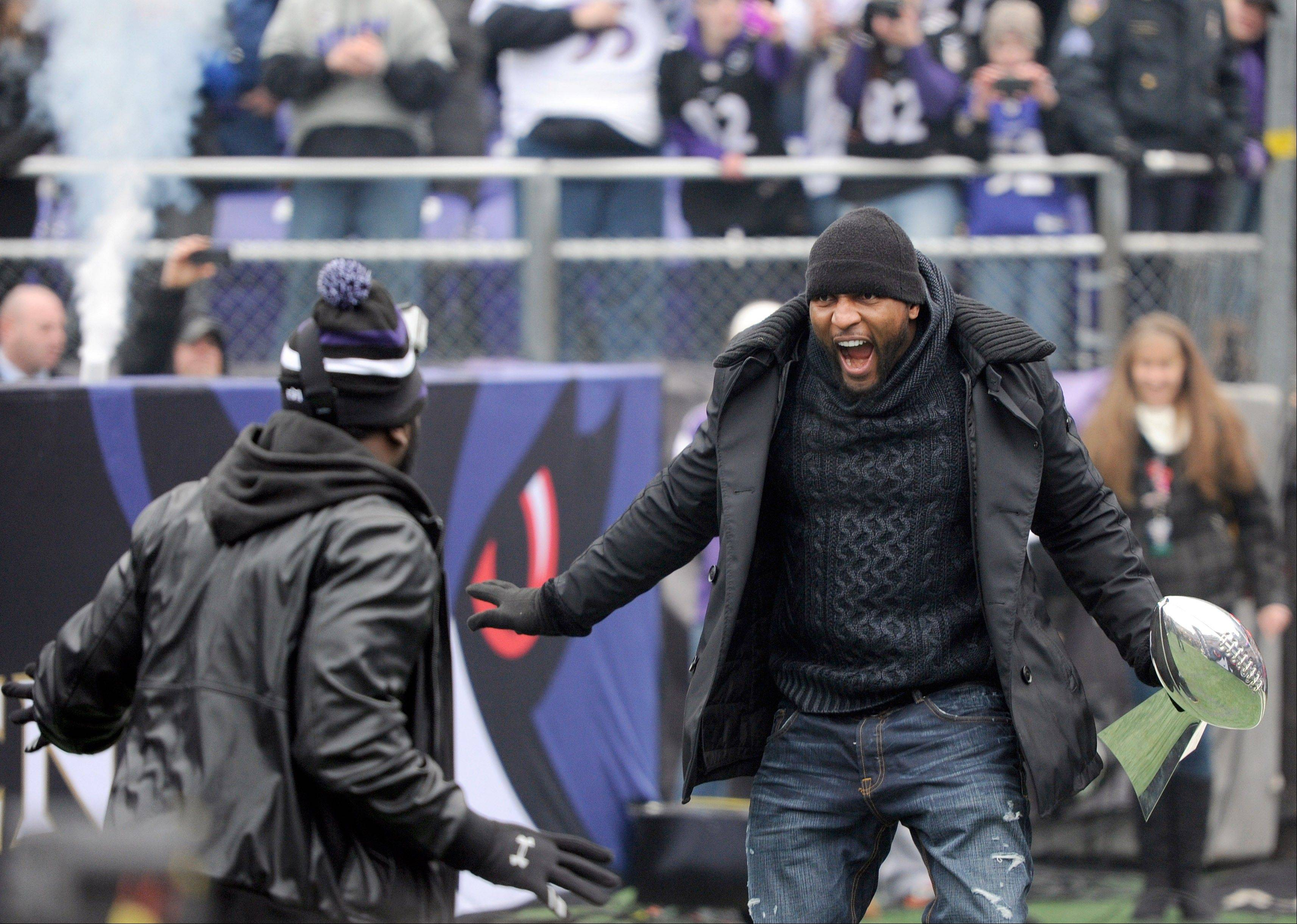 Baltimore Ravens linebacker Ray Lewis, right, and safety Ed Redd dance during a championship celebration at the team's stadium in Baltimore, Tuesday, Feb. 5, 2013. The Ravens defeated the San Francisco 49ers in NFL football's Super Bowl XLVII 34-31 on Sunday. (AP Photo/Steve Ruark)