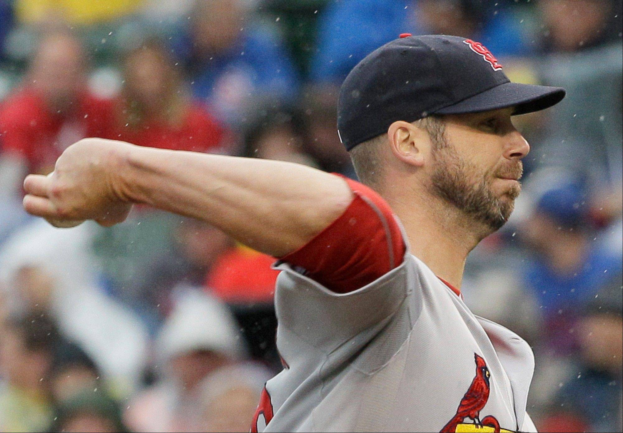 St. Louis Cardinals starter Chris Carpenter, shown here pitching against the Cubs on Sept. 21, 2012, is not expected to pitch next season due to a nerve injury, according to Cardinals GM John Mozeliak, and his pro career is likely over at age 37.