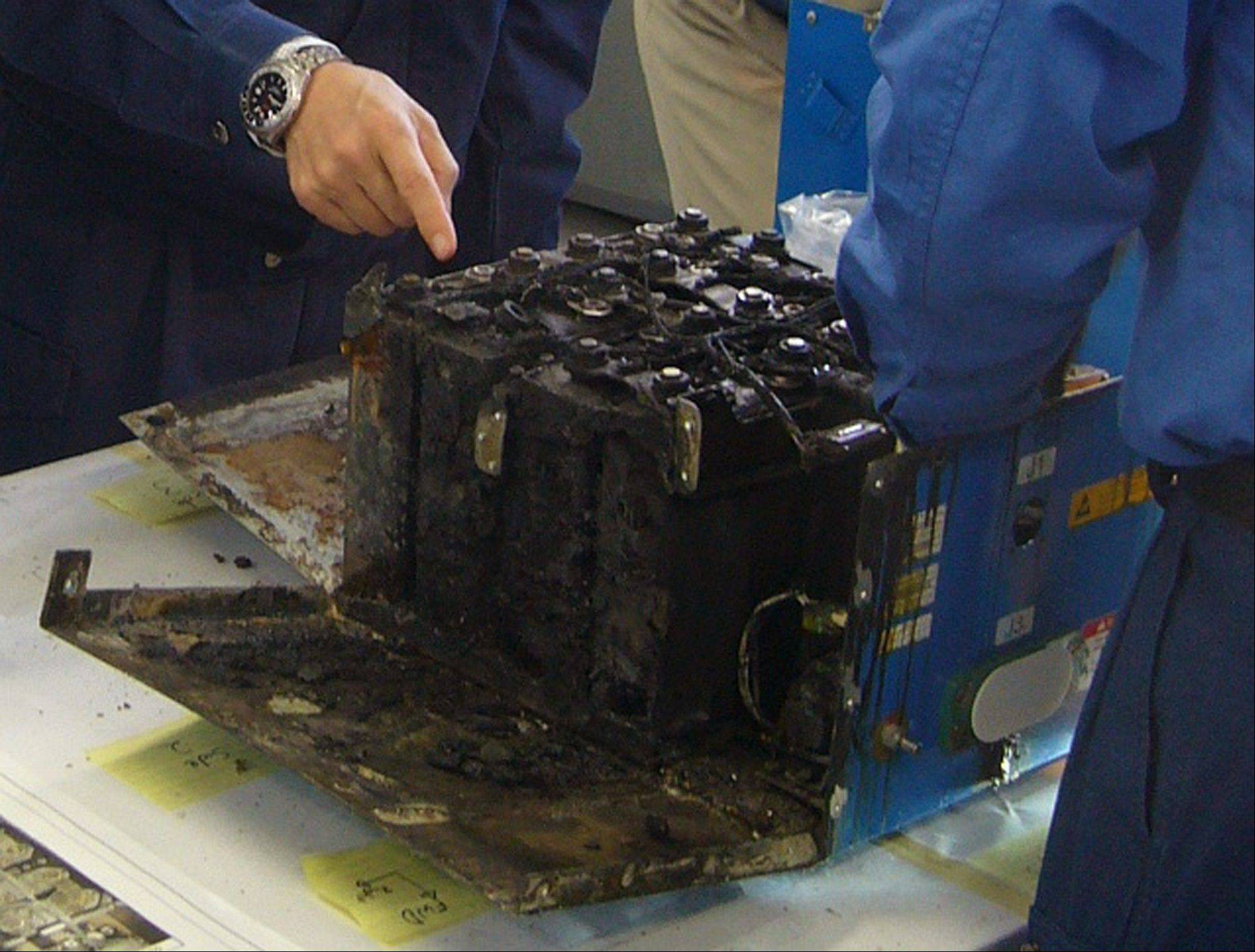 The distorted main lithium-ion battery of the All Nippon Airways' Boeing 787 which made an emergency landing, in dismantled by the investigators at its manufacturer GS Yuasa's headquarters in Kyoto, Japan.