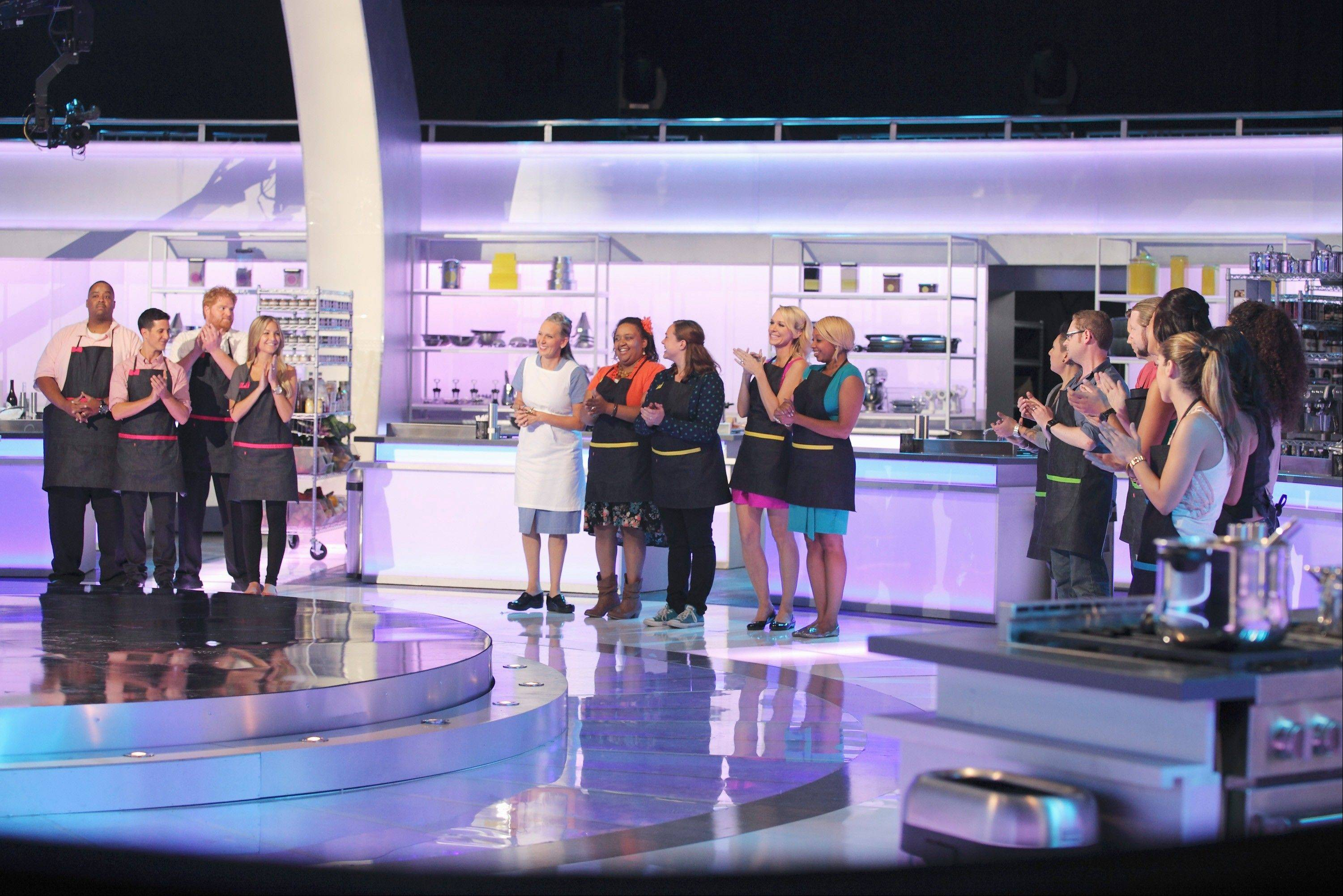 "Libertyville chef Paul Caravelli, third from left, applauds as another contestant is chosen for ""The Taste"" on ABC."