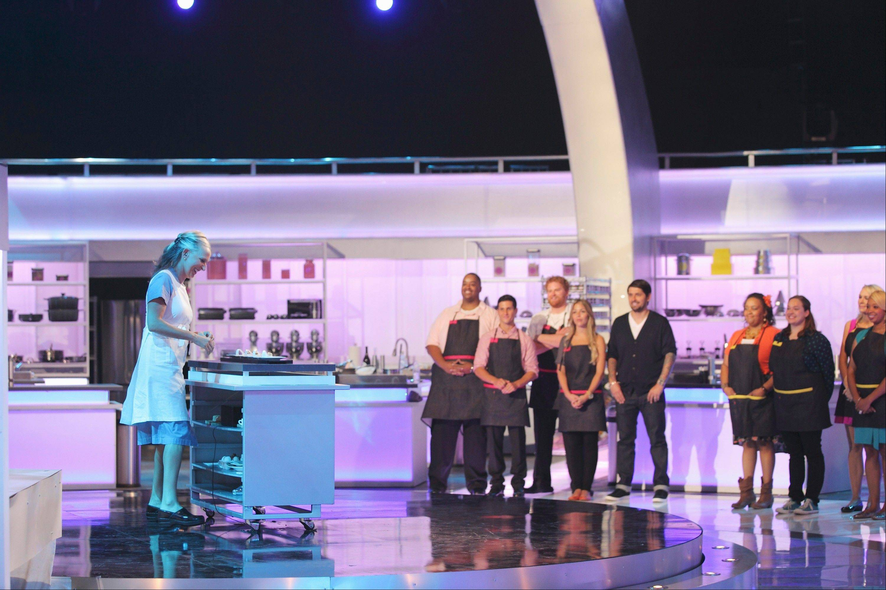 "Chef Paul Caravelli, from 545 North Bar and Grill in Libertyville, fourth from left, watches as another contestant is chosen for ""The Taste"" on ABC."