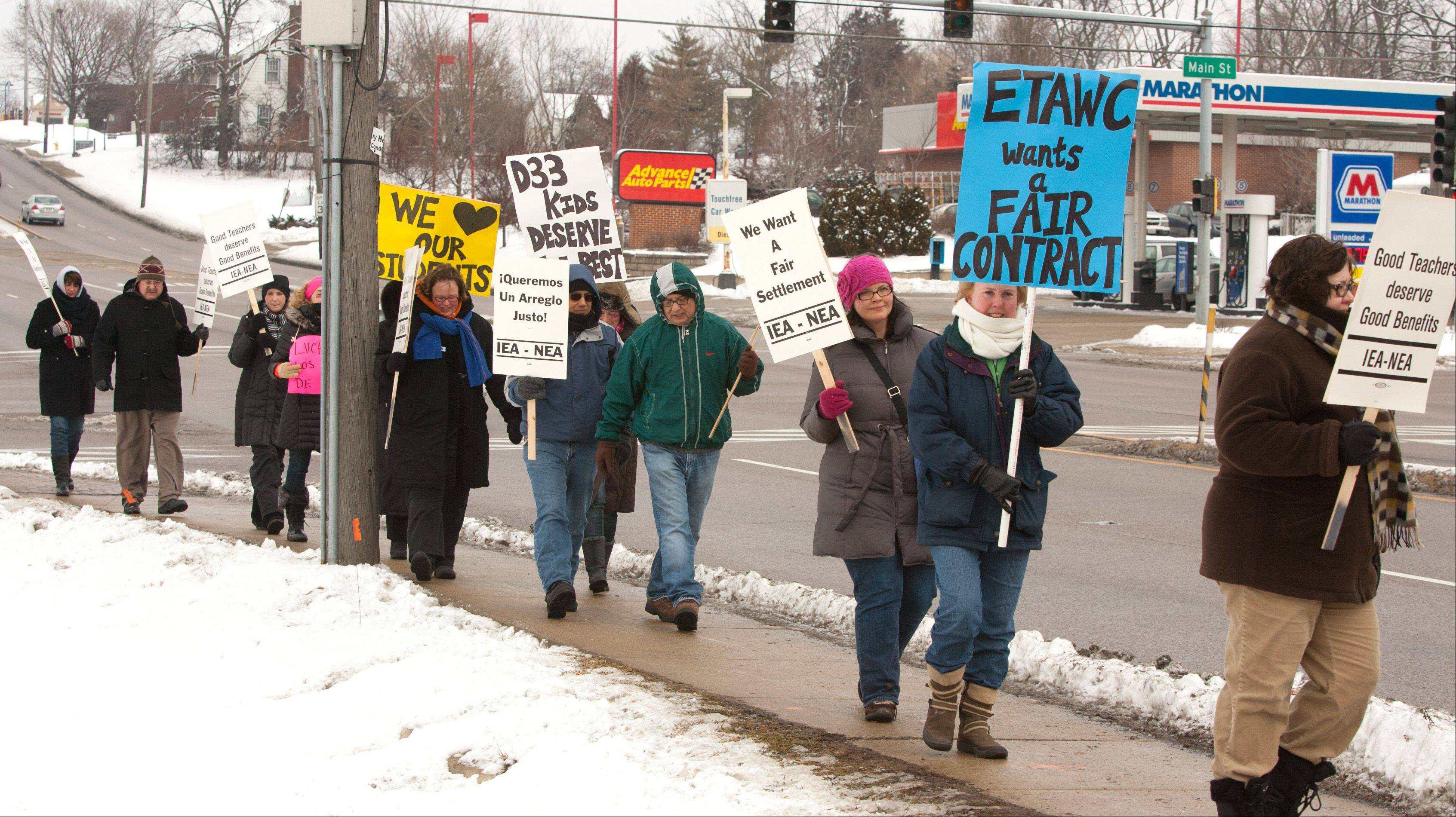 West Chicago Elementary District 33 teachers walk a picket line Tuesday at Route 59 and Main Street.