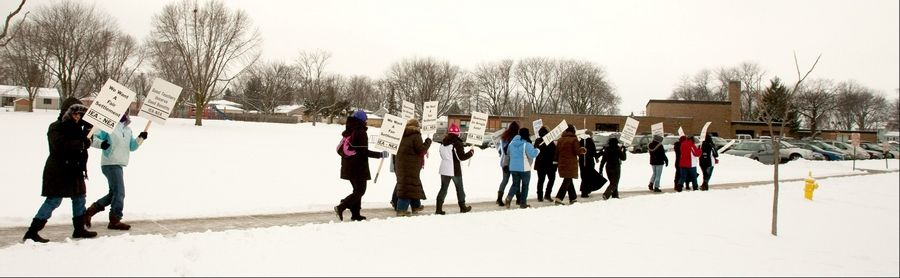 West Chicago Elementary District 33 teachers walk a picket line Tuesday in front of Gary School. The strike began Monday.