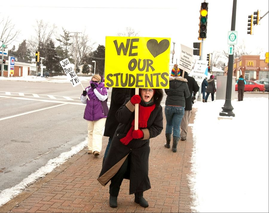 Music teacher Jane Sundberg, along with other West Chicago Elementary District 33 teachers, walks a picket line Tuesday at Route 59 and Main Street.