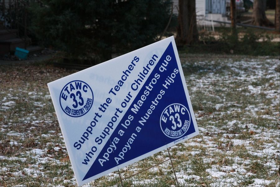 Signs in support of the teachers union in West Chicago have begun to pop up on front lawns.