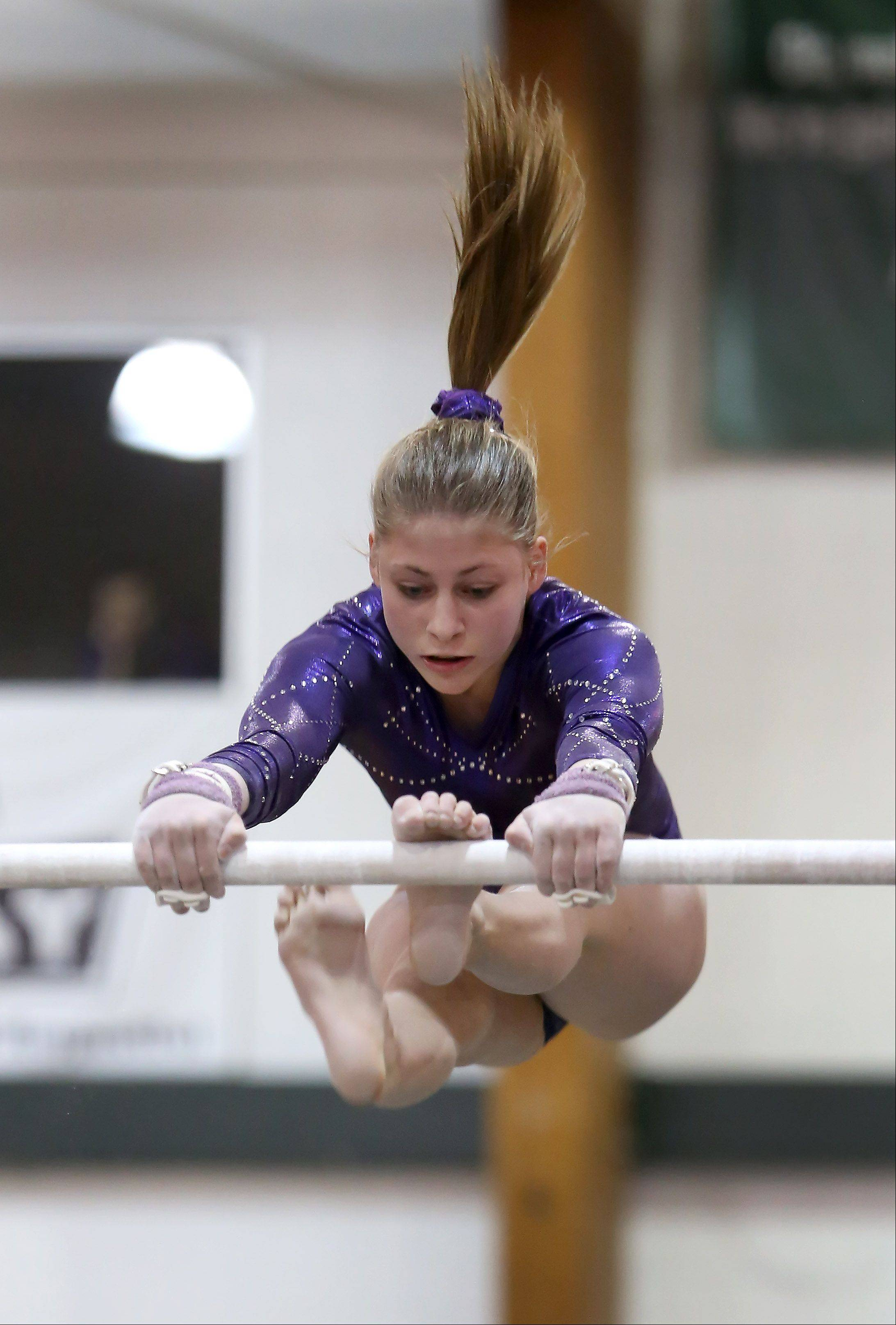Rachel Dugan of St. Charles co-op performs on the uneven parallel bars during gymnastics sectional at Glenbard West on Tuesday in Glen Ellyn.