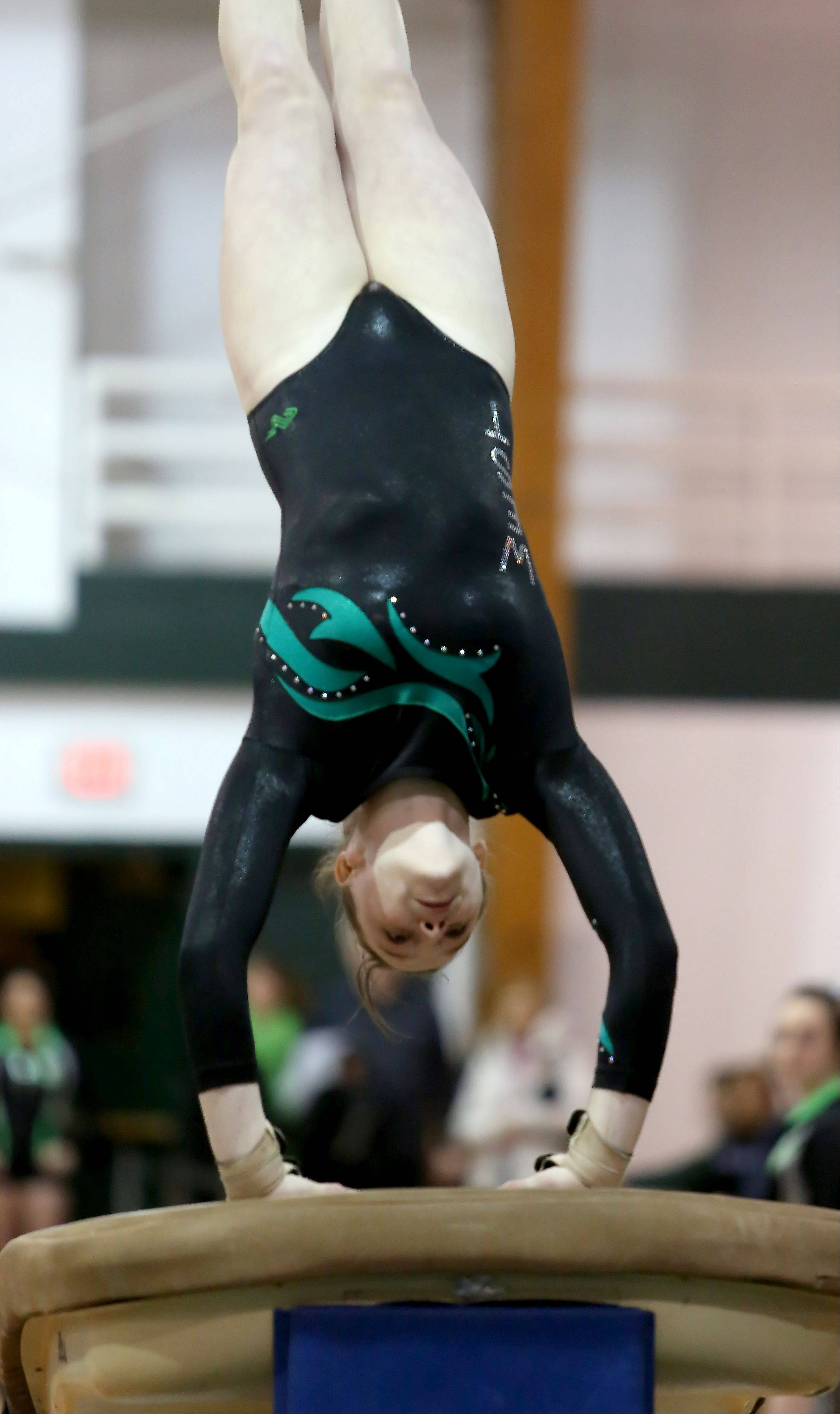 Mackenzie O'Keefe of Glenbard West performs on the vault during sectional gymnastics at Glenbard West on Tuesday in Glen Ellyn.