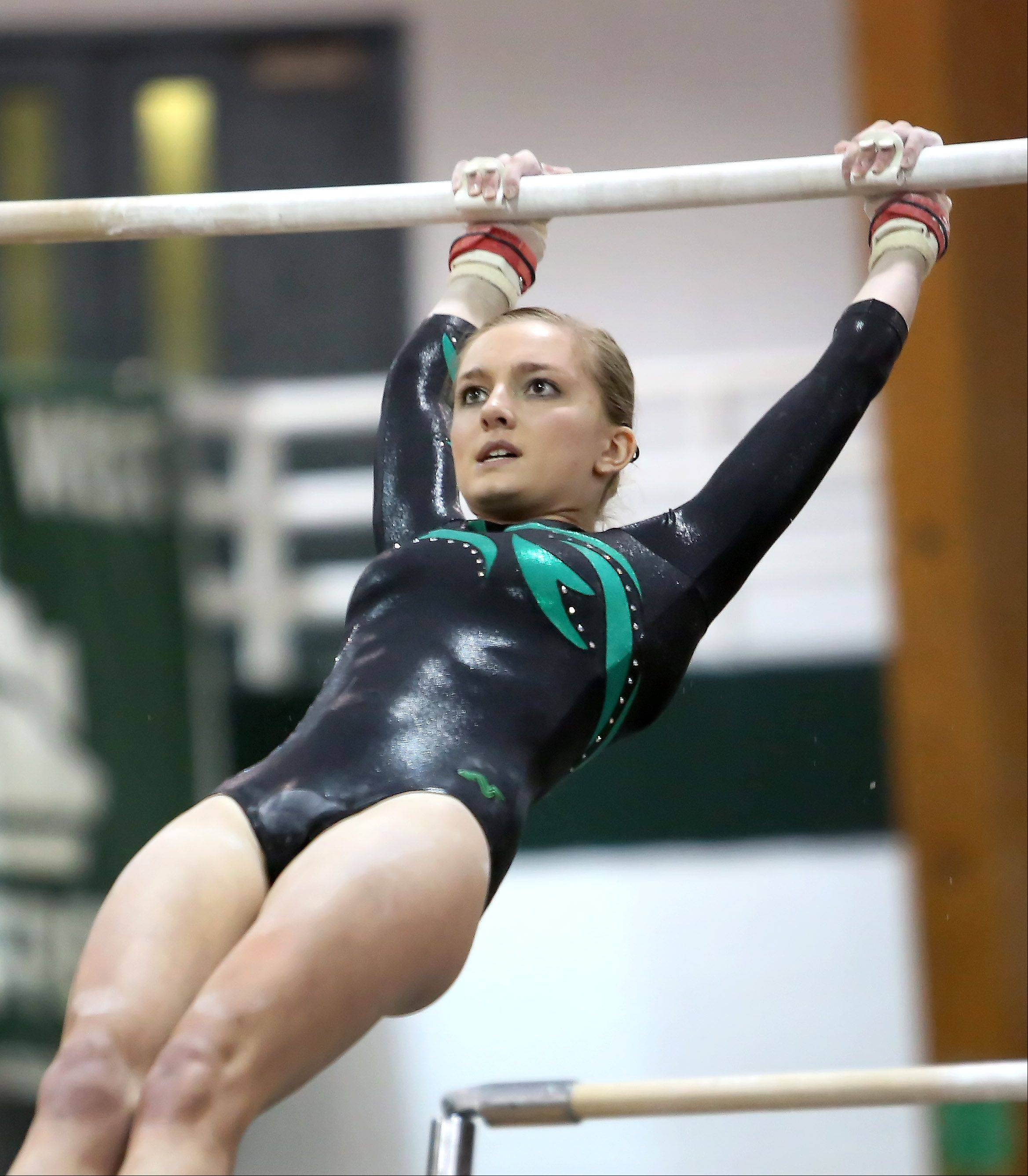 Maggie Phillips of Glenbard West performs her uneven parallel bars routine at sectional gymnastics at Glenbard West on Tuesday in Glen Ellyn.
