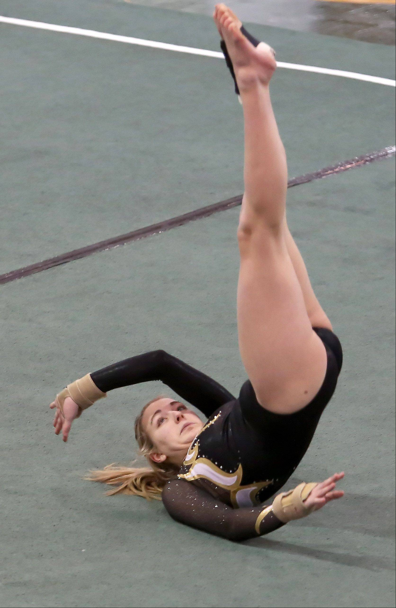 Erin Panhorst of Glenbard North performs her floor routine at sectional gymnastics at Glenbard West on Tuesday in Glen Ellyn.