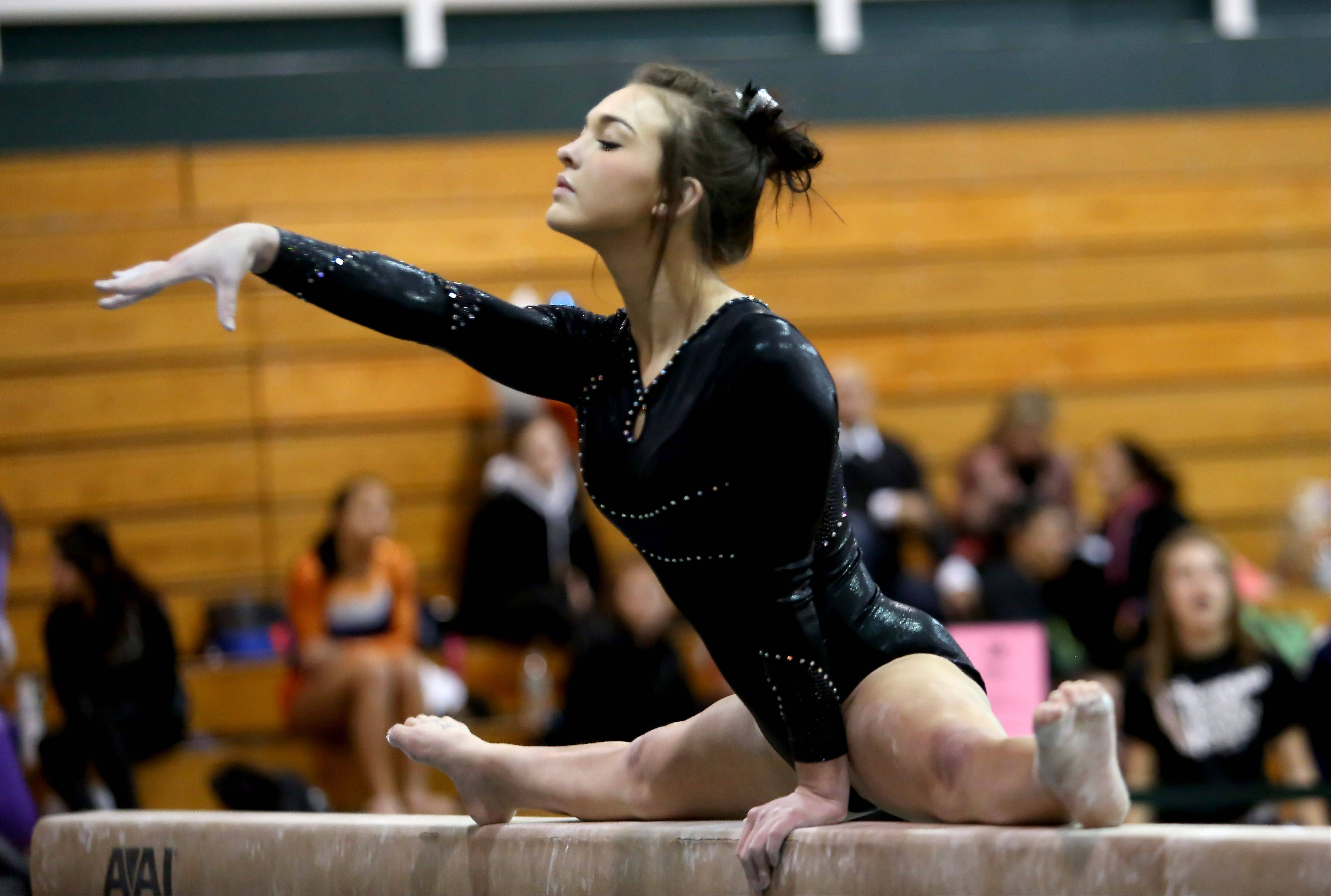 Alyssa Konkel of Bartlett co-op performs her beam routine at the sectional gymanstics championship at Glenbard West on Tuesday in Glen Ellyn.