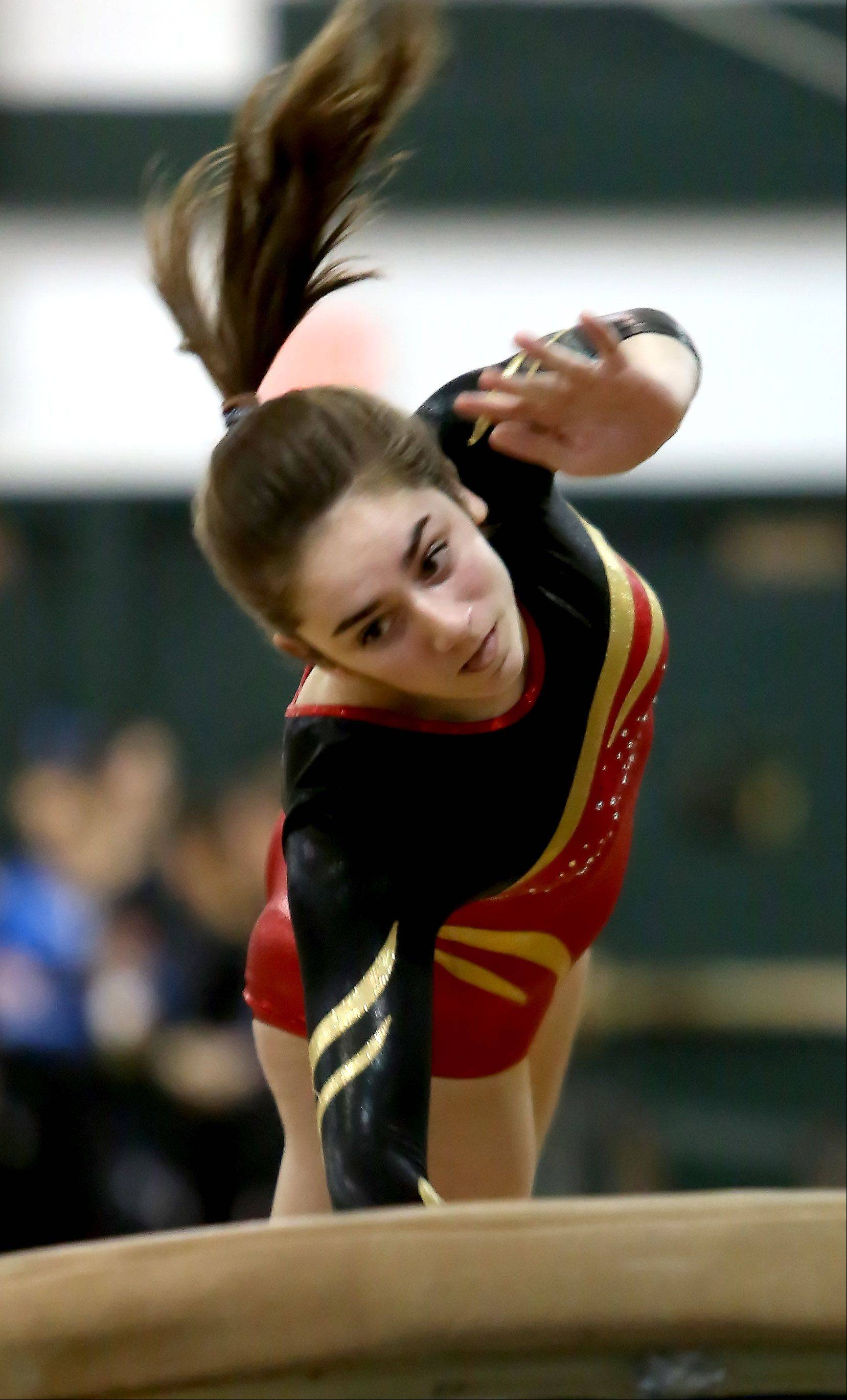 Megan McGee of Batavia performs on the vault during gymnastics sectional at Glenbard West on Tuesday in Glen Ellyn.