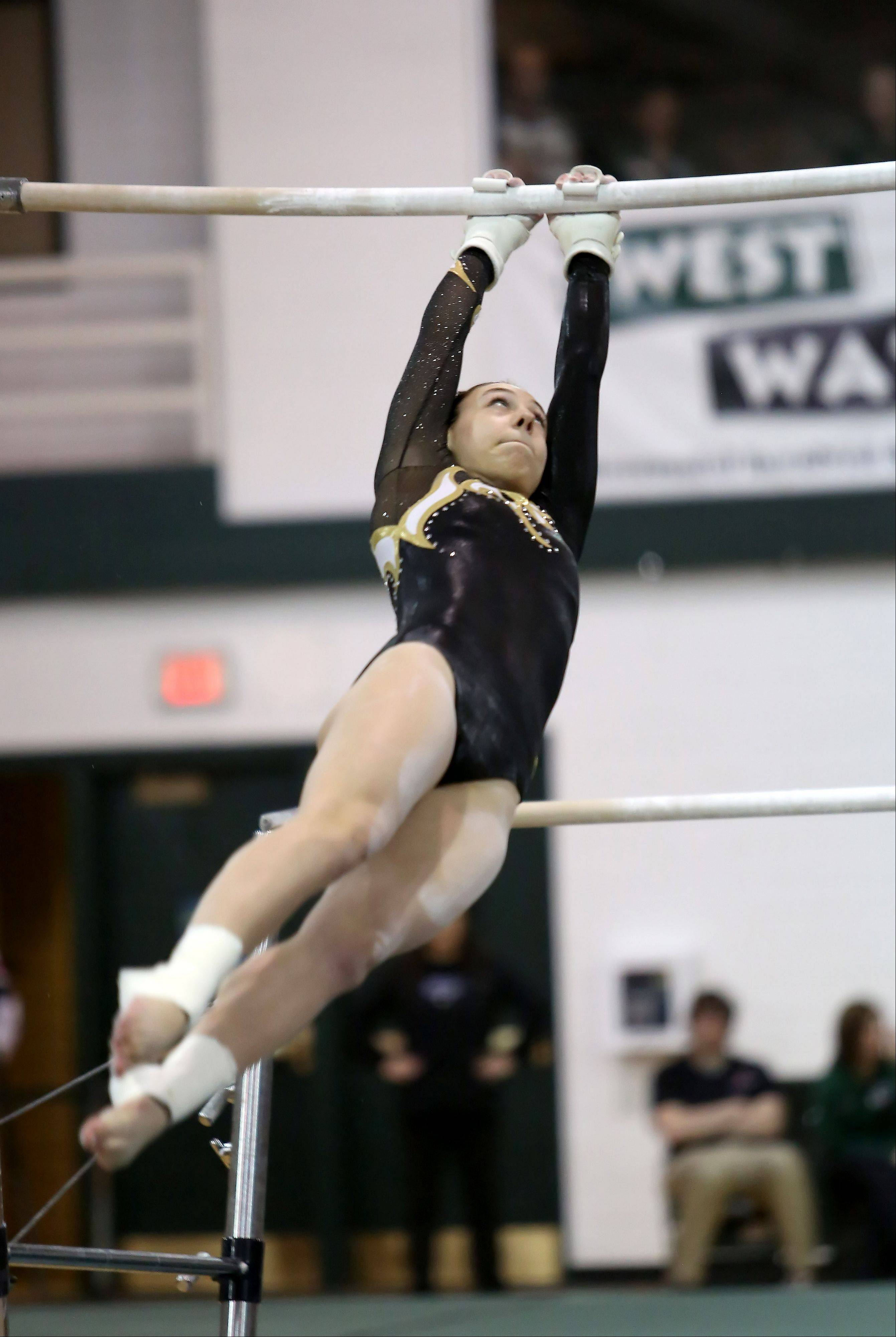 Mariah Matesi of Glenbard North performs on the uneven parallel bars during sectional gymnastics at Glenbard West on Tuesday in Glen Ellyn.