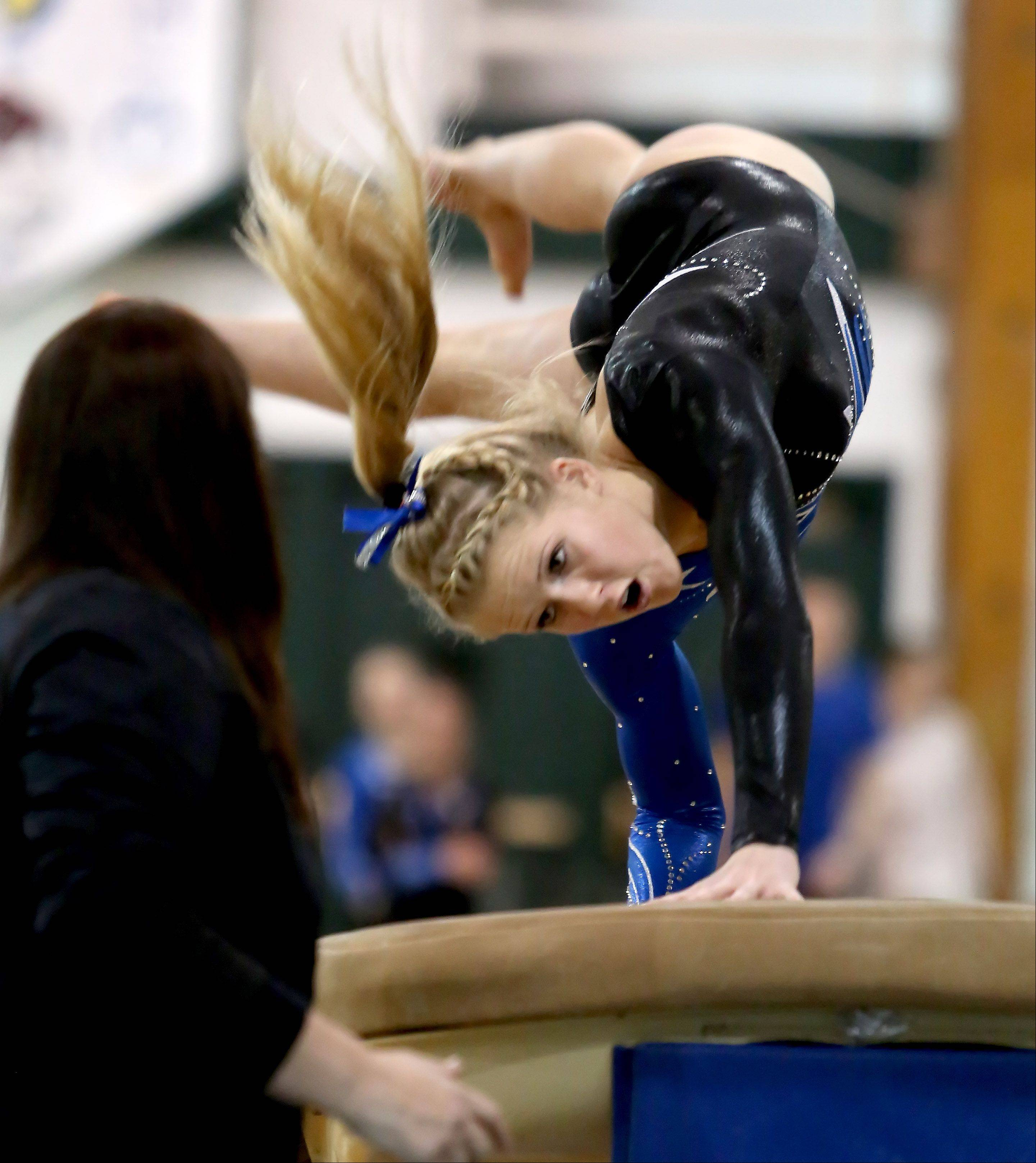 McKenna Merges of Geneva performs on the vault during sectional gymnastics at Glenbard West on Tuesday in Glen Ellyn.