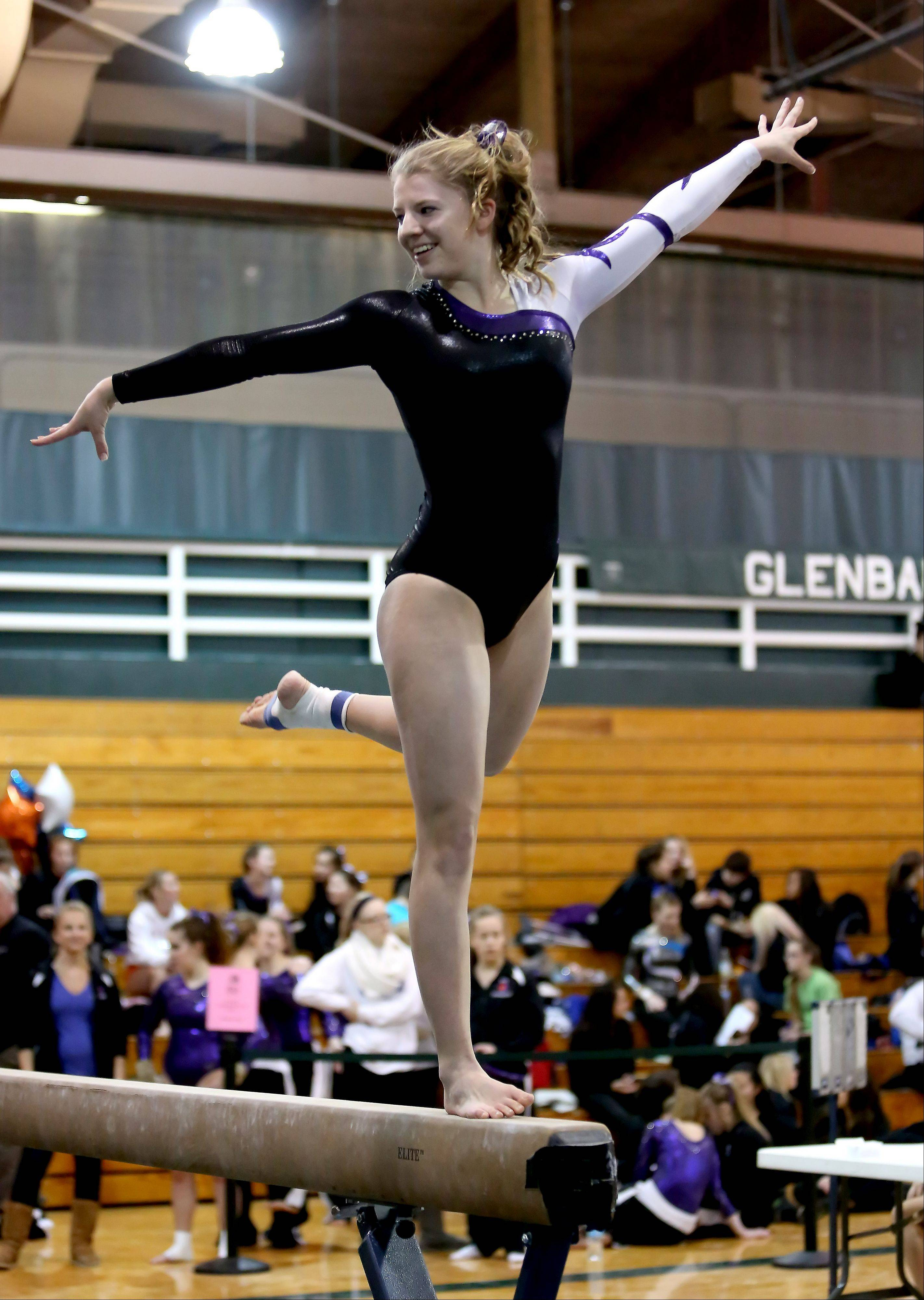 Brianna Mulhearn of Wheaton co-op performs her beam routine at sectional gymnastics at Glenbard West on Tuesday in Glen Ellyn.