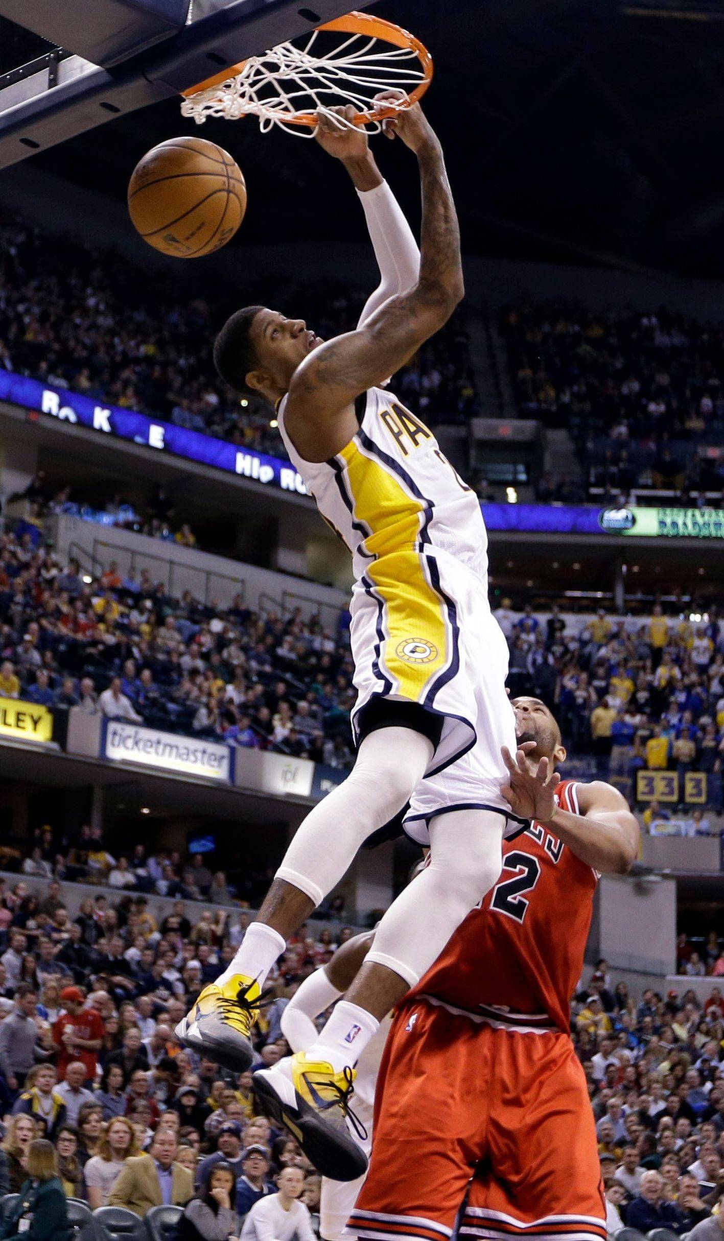 Paul George gets a reverse dunk over Taj Gibson during the Indiana's victory Monday. The Pacers' big flaw was lack of a legitimate scorer, but that problem has been erased with the emergence of George.