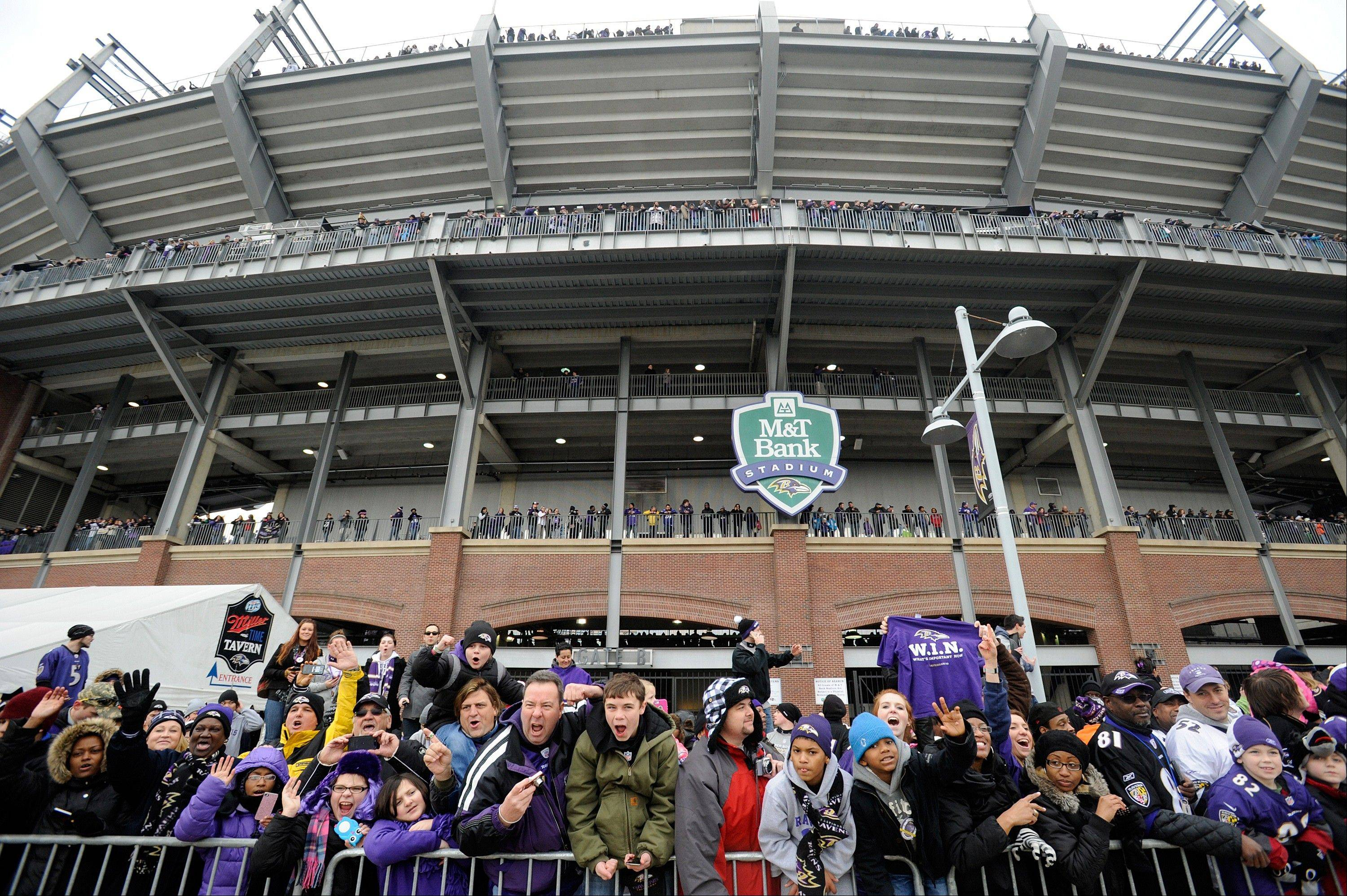 Baltimore Ravens NFL football fans cheer for the team outside of M&T Bank Stadium as the parade arrives during a celebration of the team's Super Bowl championship in Baltimore Tuesday, Feb. 5, 2013. The Ravens defeated the San Francisco 49ers 34-31 in Super Bowl XLVII on Sunday.