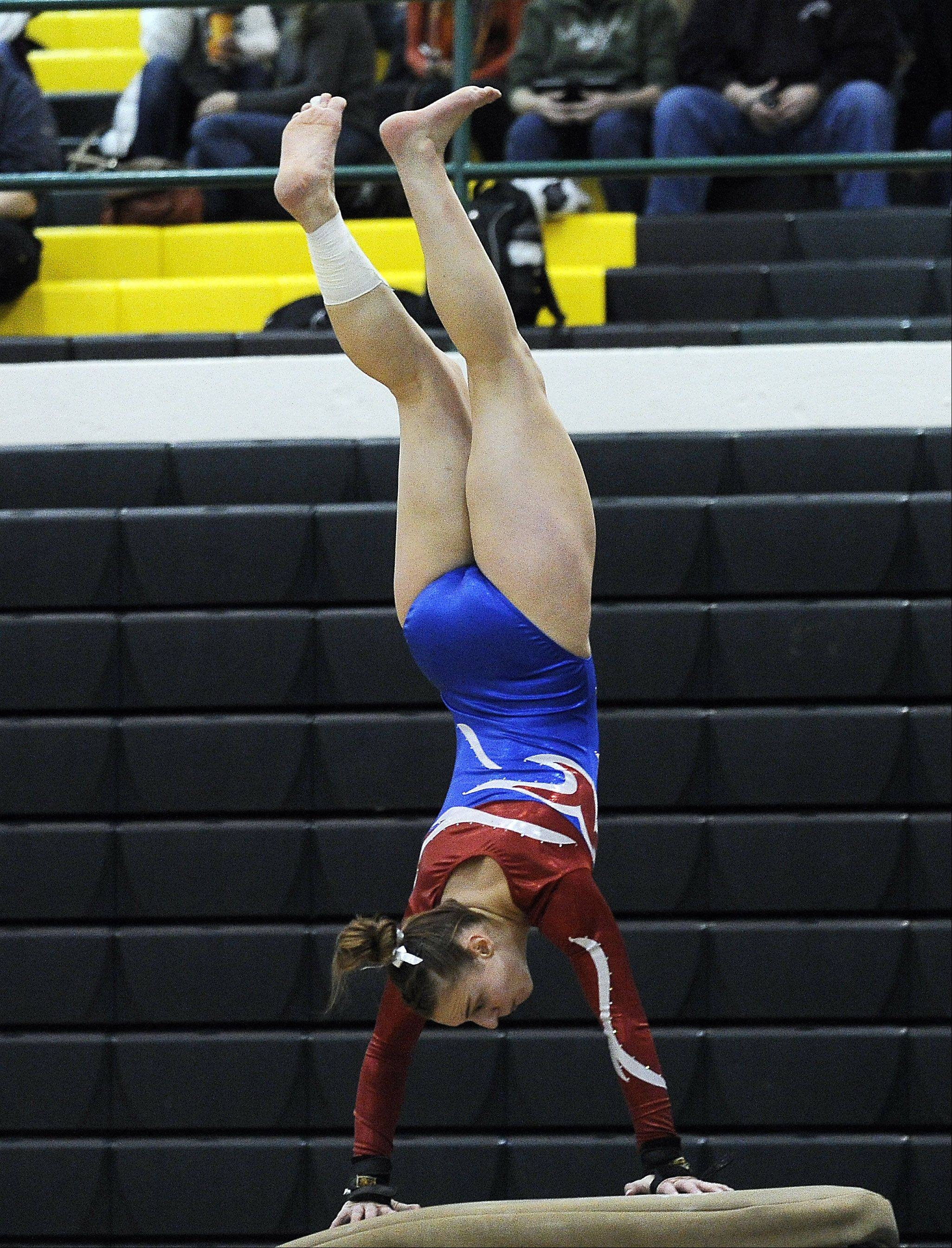 Dundee-Crown's Claire Blume rockets off the vault during sectional action Monday at Fremd.