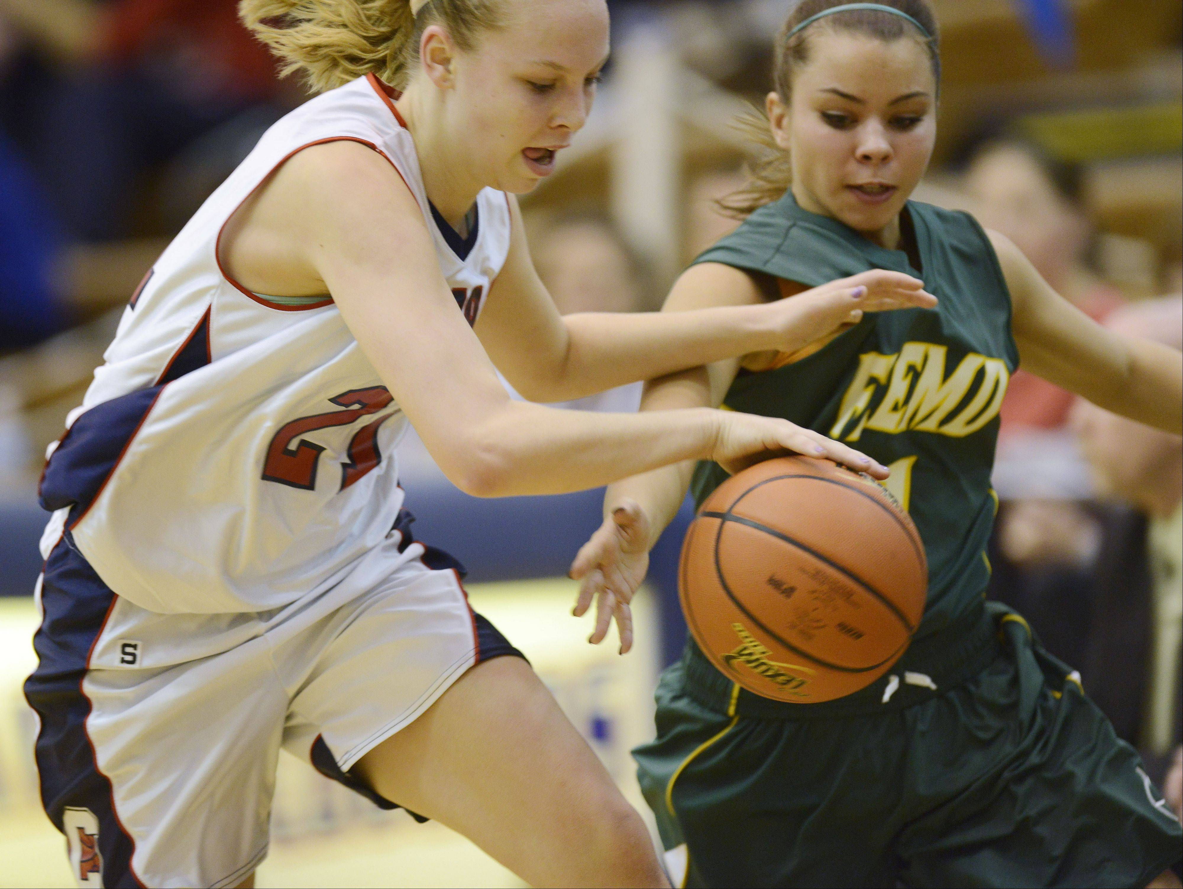 Conant's Katie Lomas, left, and Fremd's Catherine Ernst chase after a loose ball during Tuesday's game.