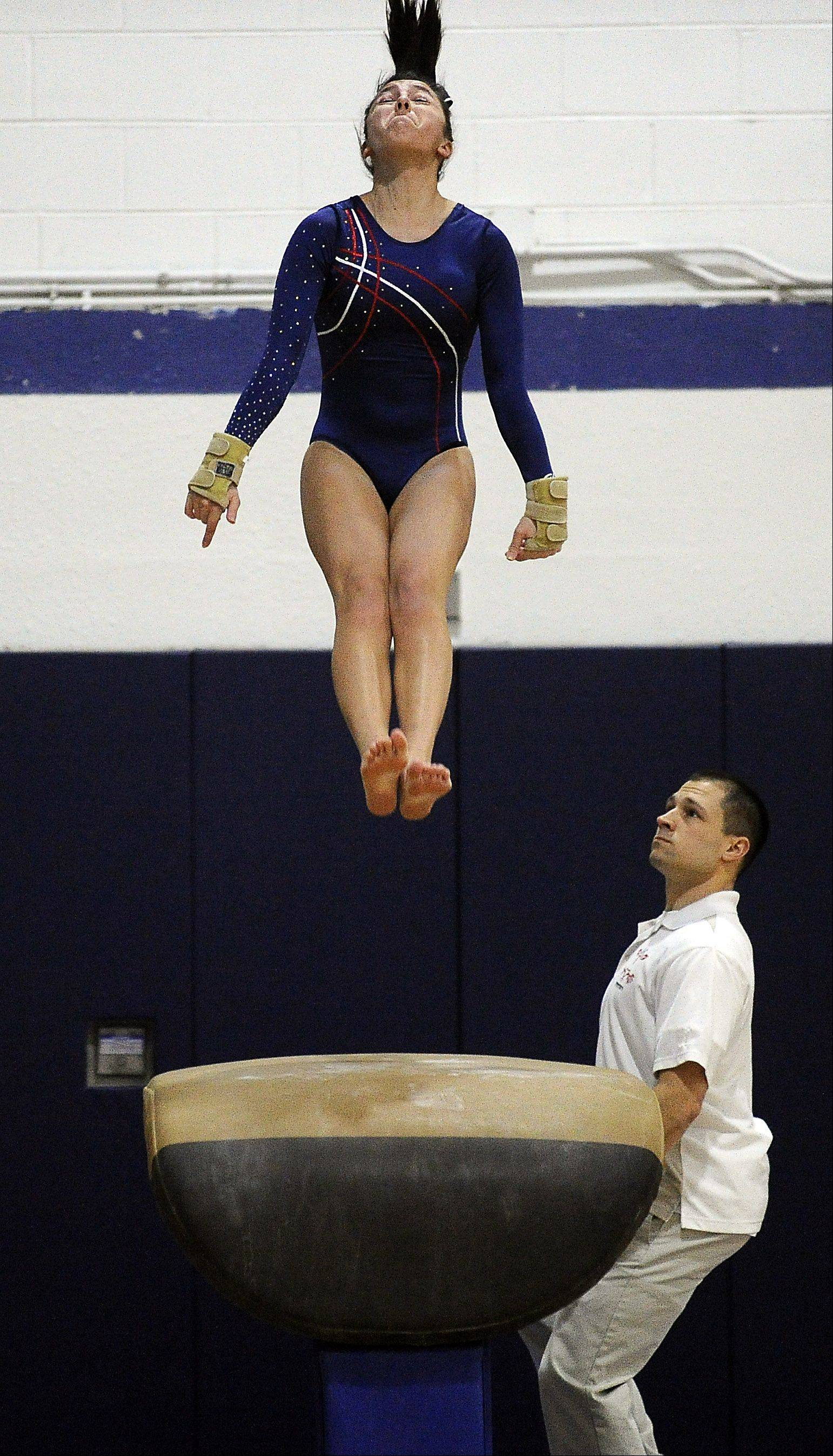 Conant's Sarah Zorrilla competes on the vault during Thursday's gymnastics regionals at Conant High School.